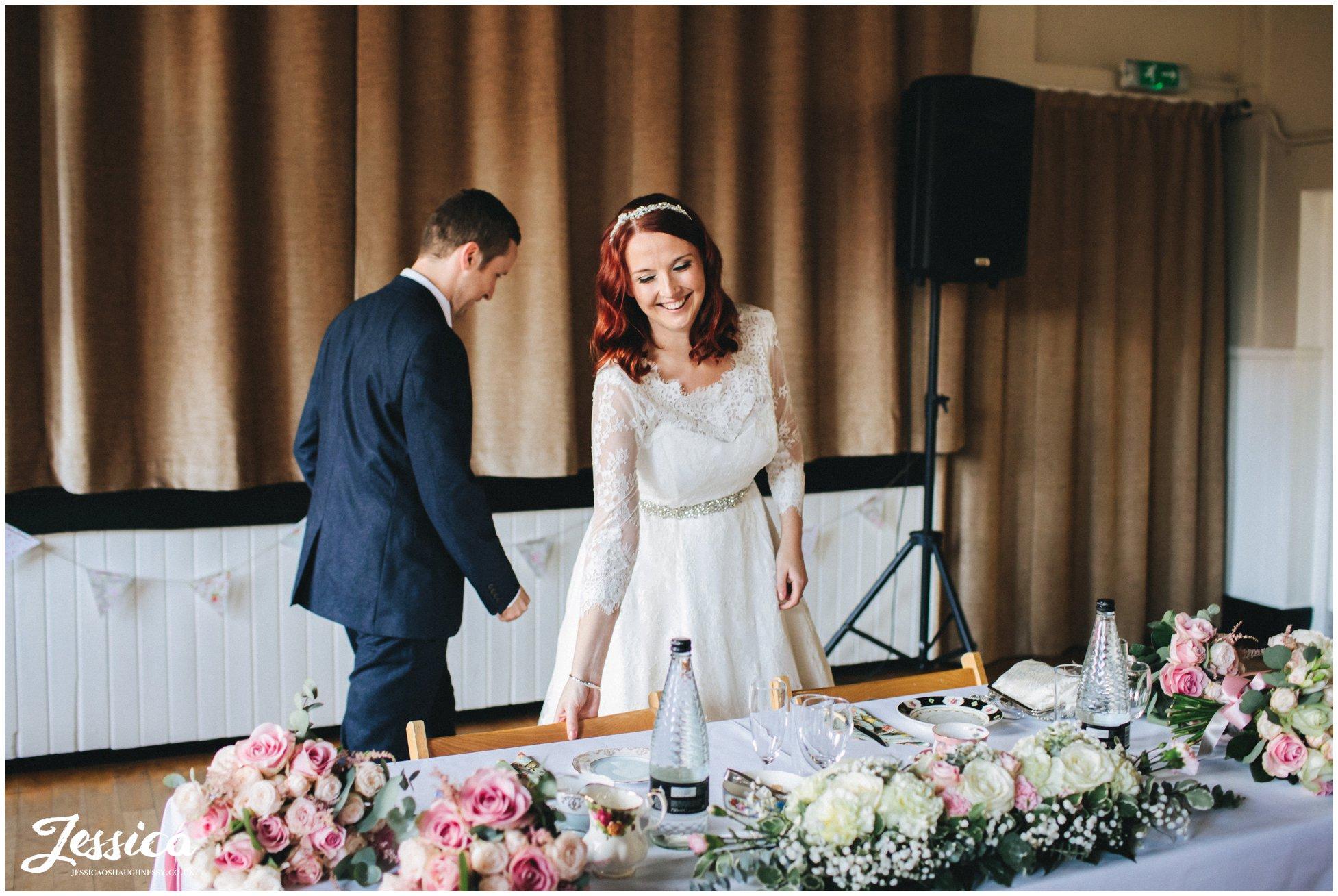 bride & groom sit down for their wedding breakfast