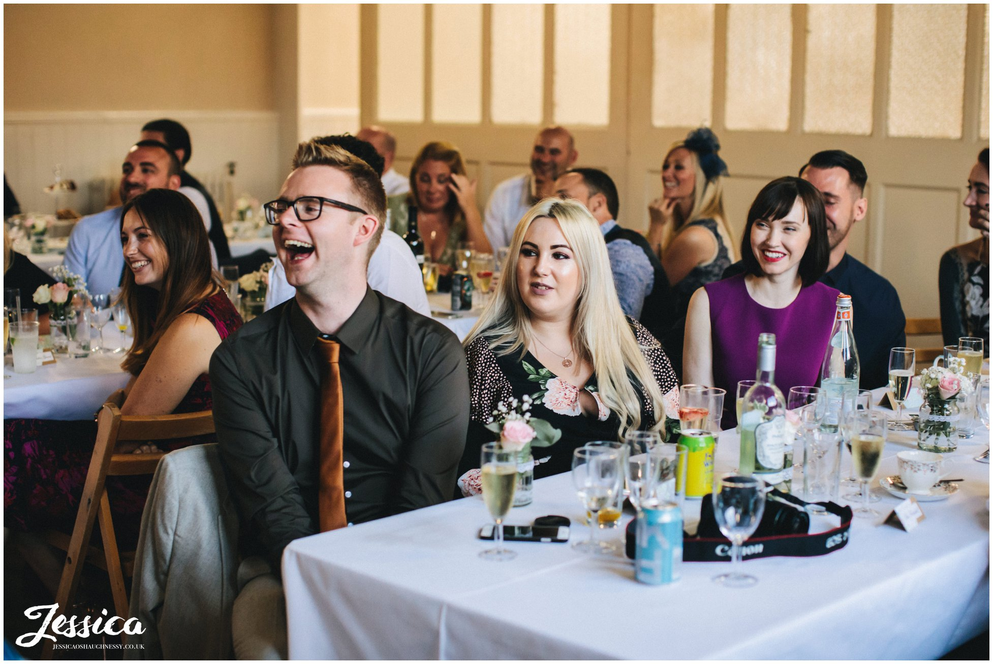 wedding guests enjoy the speeches at a manchester wedding