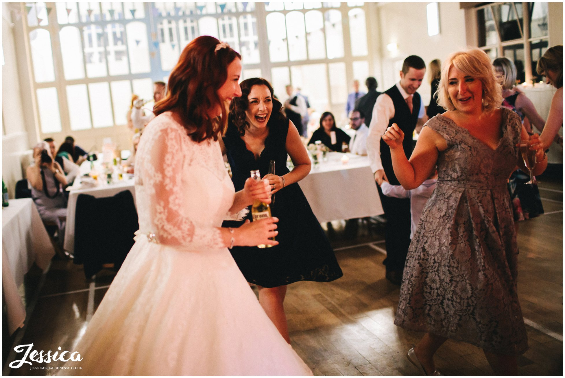 bride dances with her bridesmaids at her manchester wedding