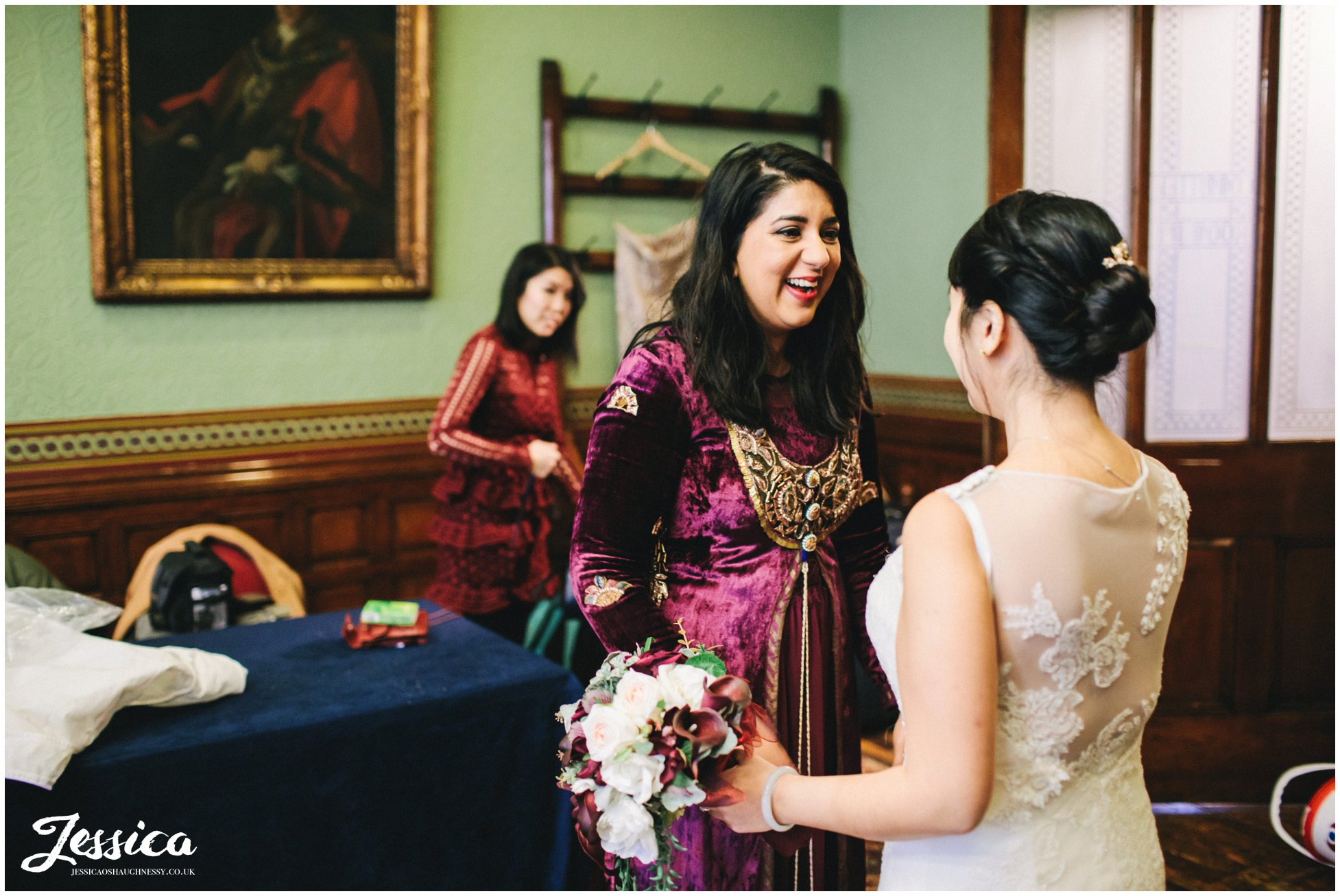 bridesmaid greets bride before the wedding in manchester