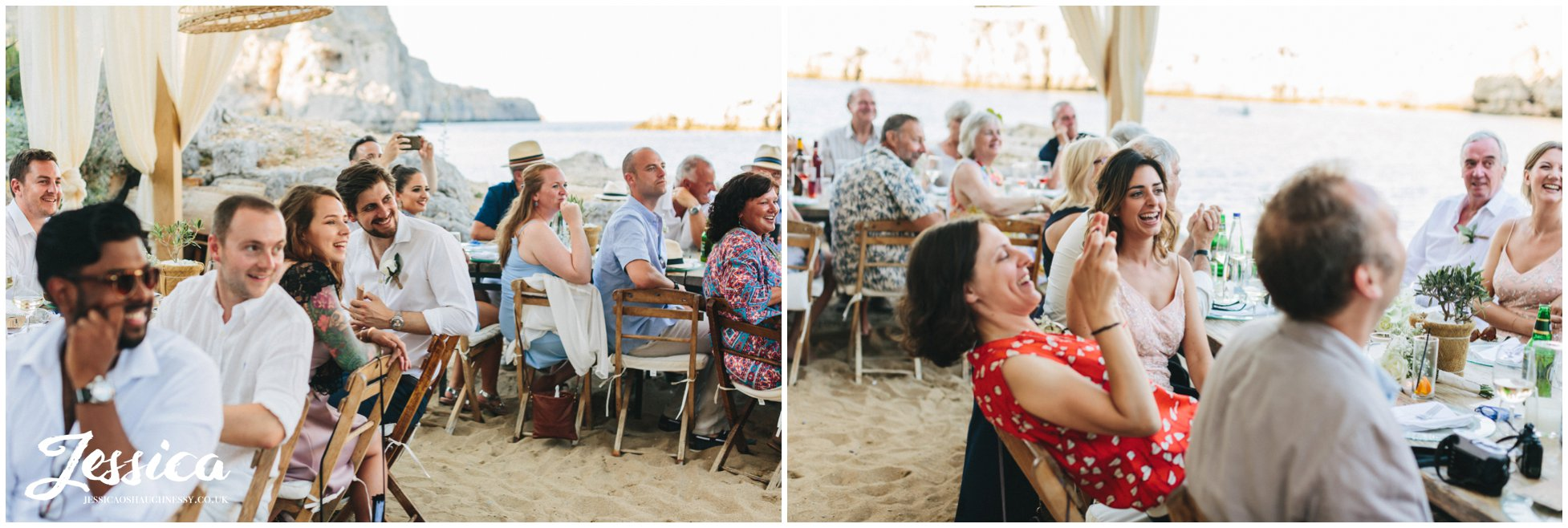 wedding guests listen to the speeches with sand under their feet