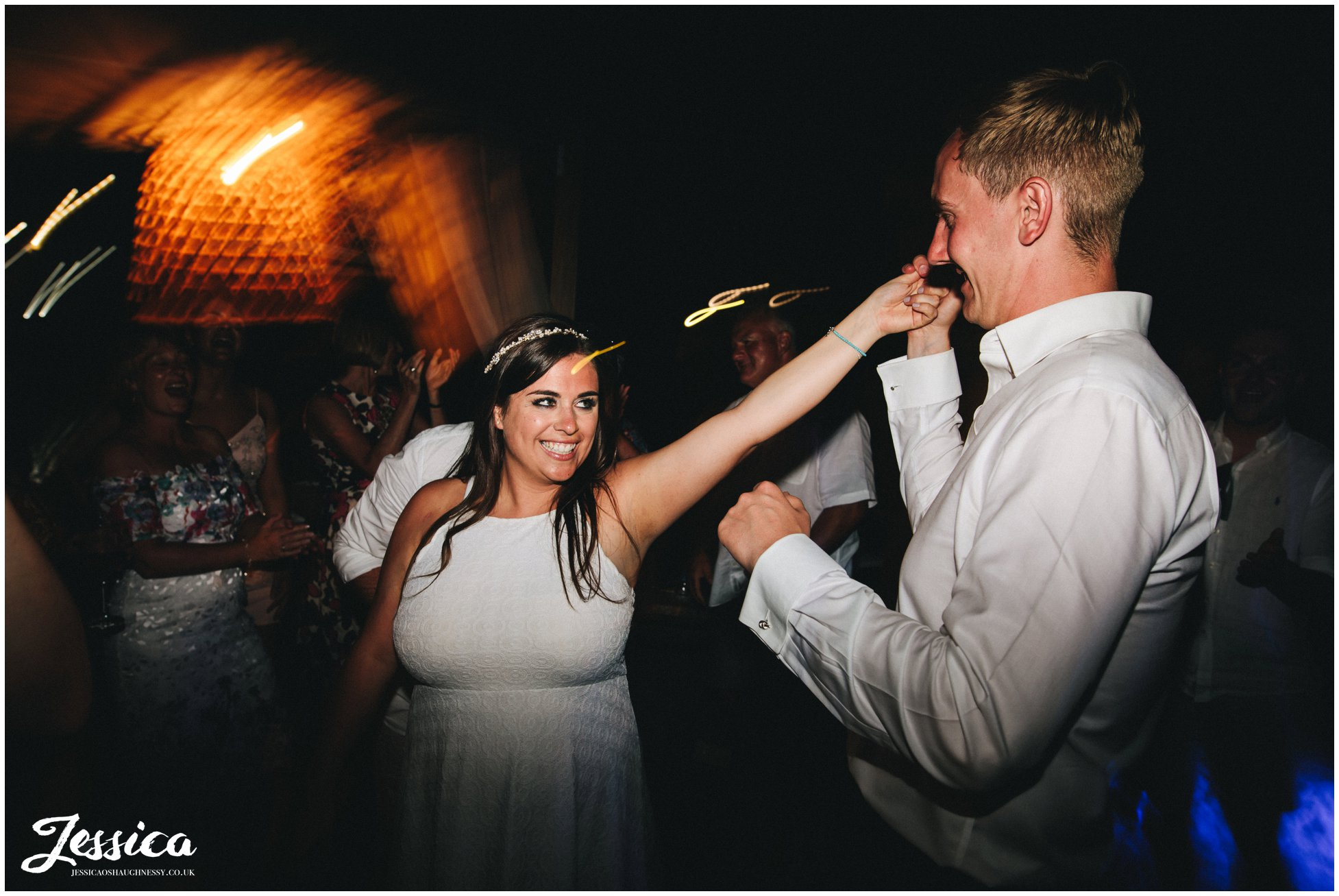 bride changes into an evening dress for dancing
