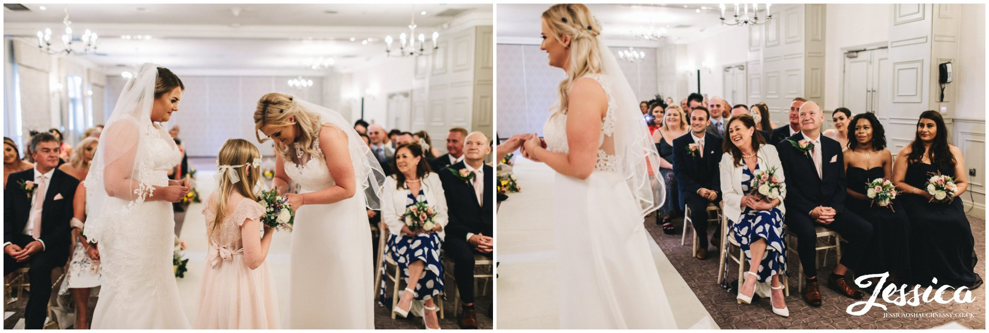 the flower girl gives the brides their rings to exchange