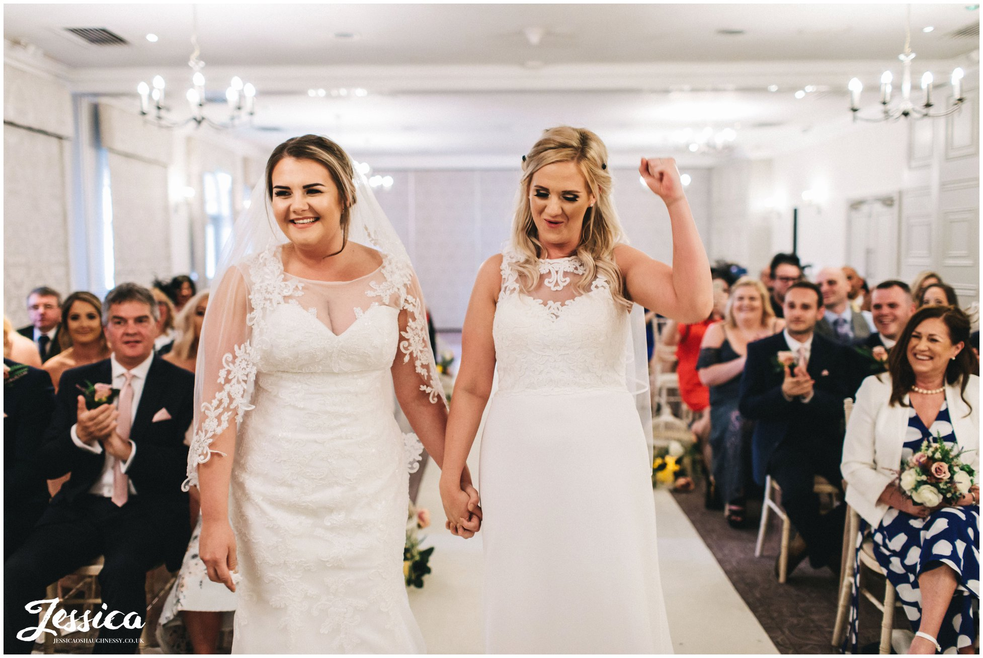 one bride cheers after they exchange their vows