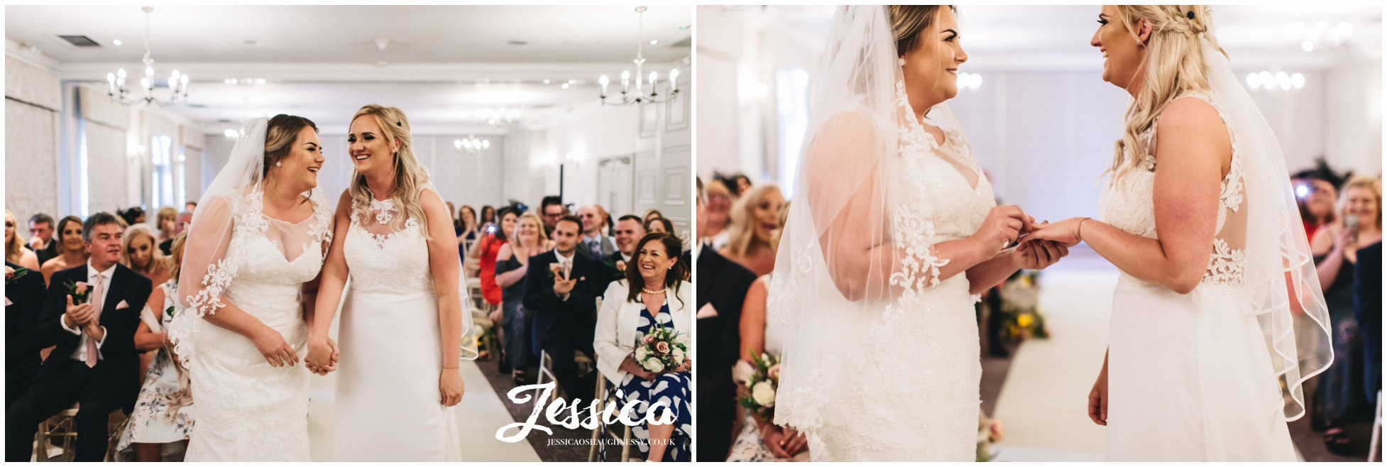 the two brides exchange rings at their mottram hall wedding ceremony