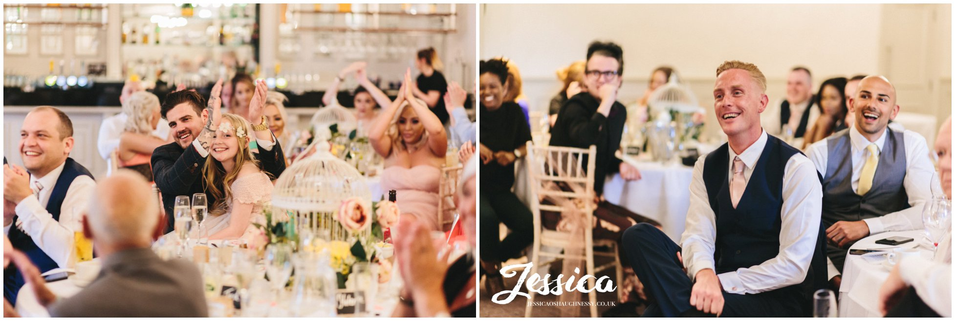 the best man and wedding guests clap after the speeches are over