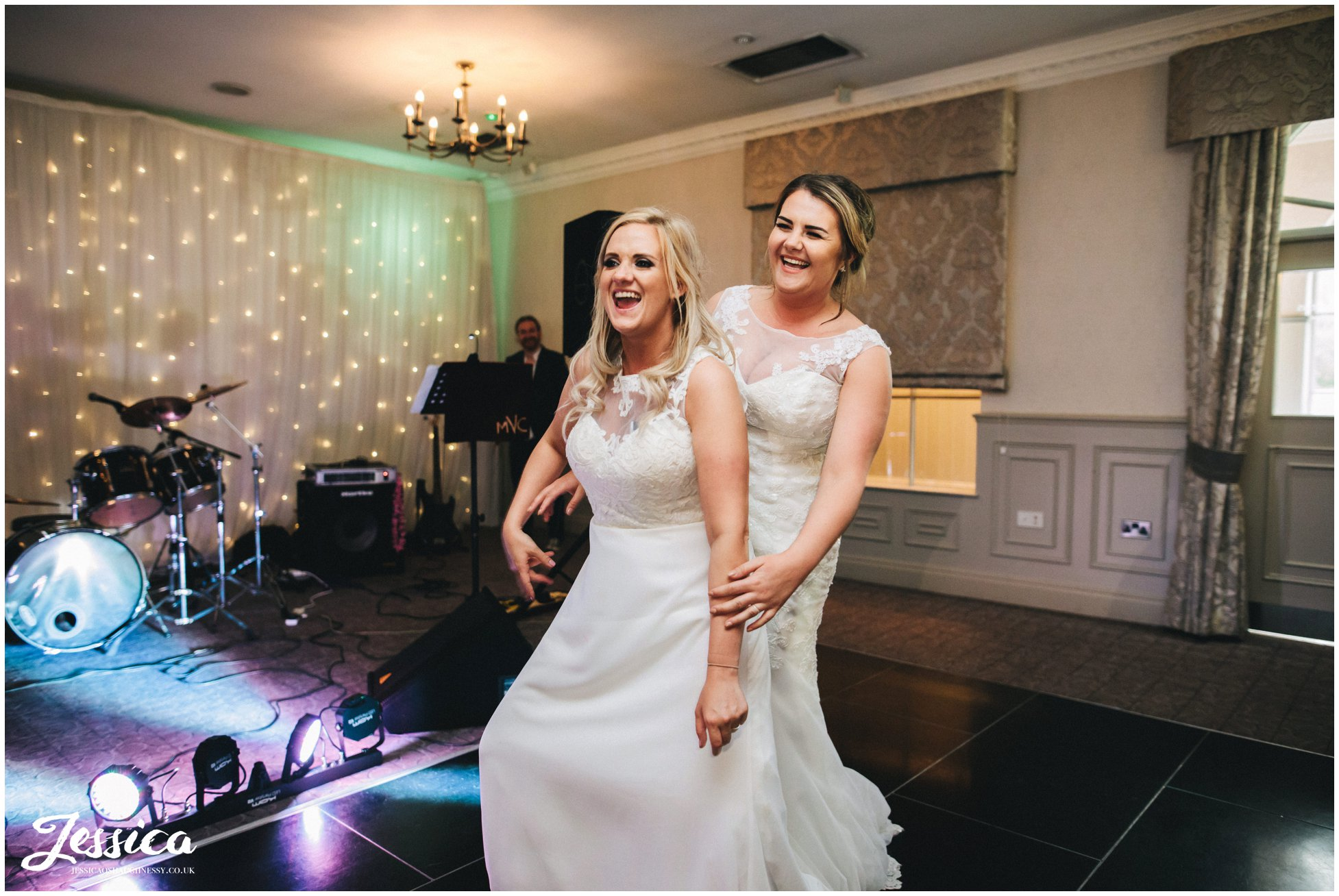 the brides laugh as they share their first dance at mottram hall