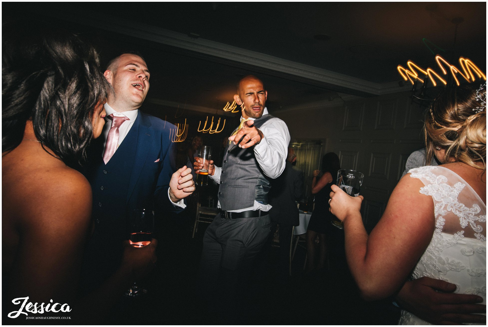 guests enjoying the celebrations on the dancefloor for the new couple