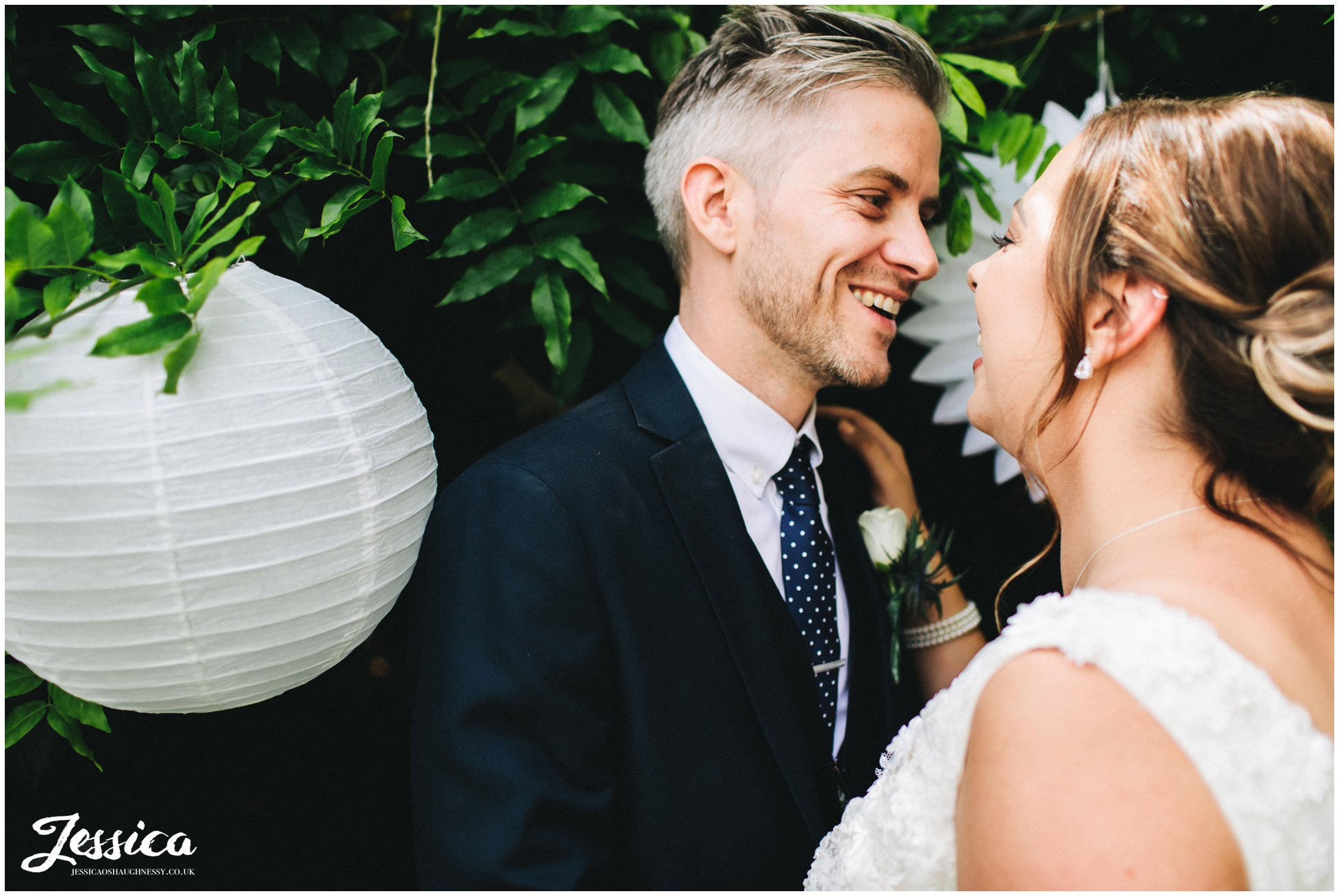 the groom smiles at his wife on the cheshire wedding day