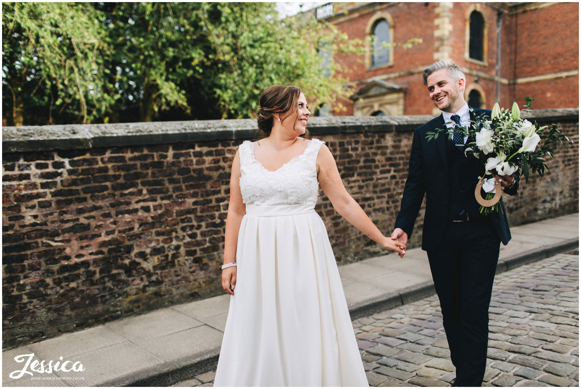 bride smiles at her new husband at belle epoque in cheshire
