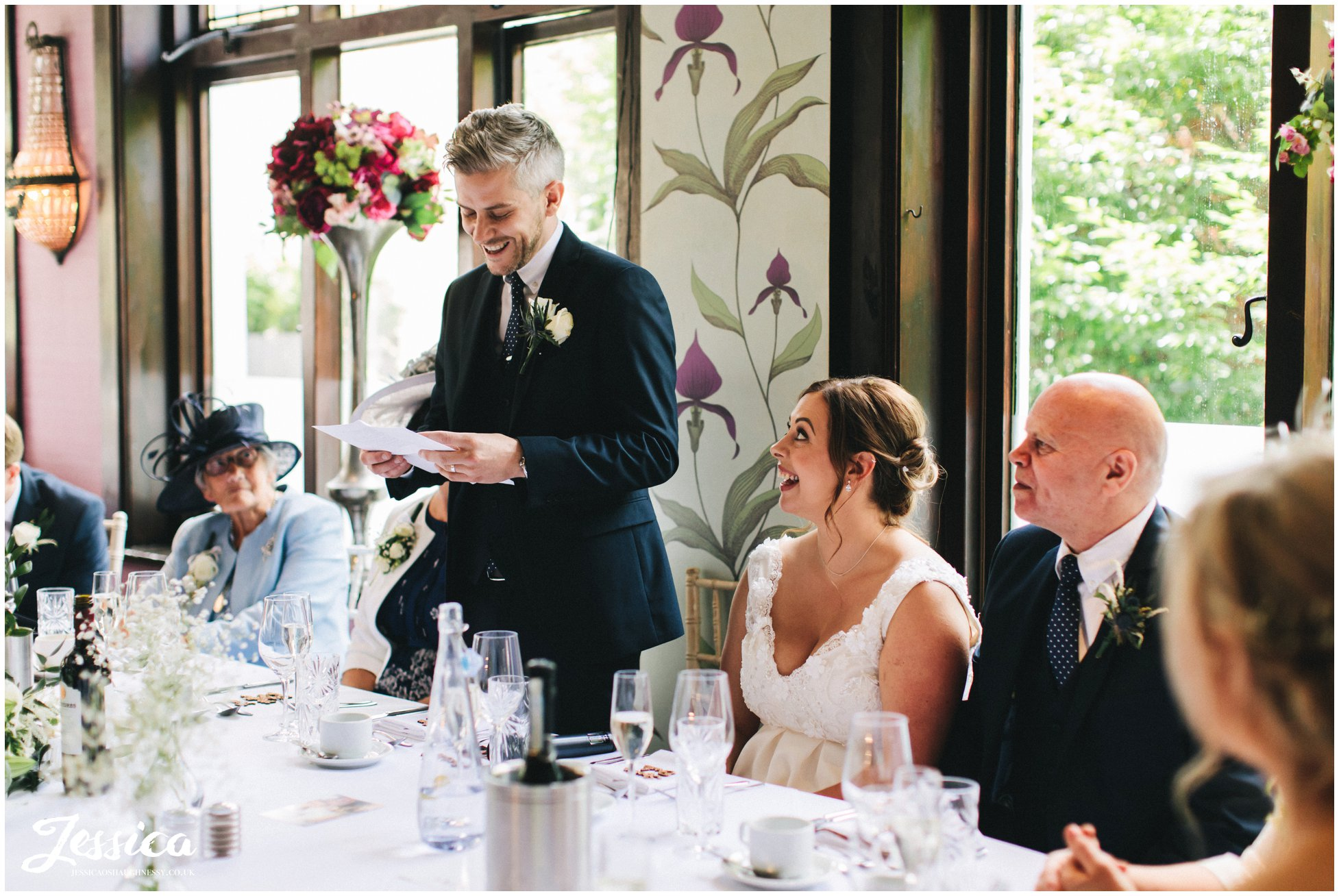 the groom stands to give his speech at belle epoque wedding venue