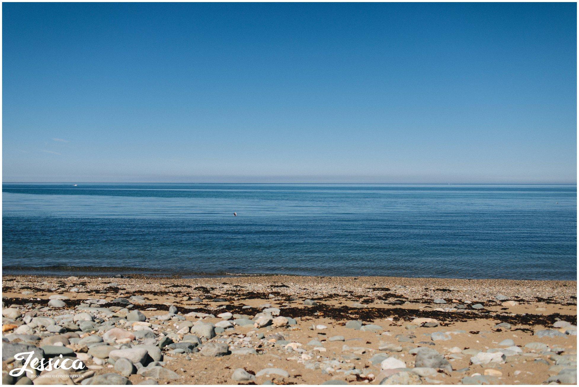 Caernarfon bay with perfect blue skies