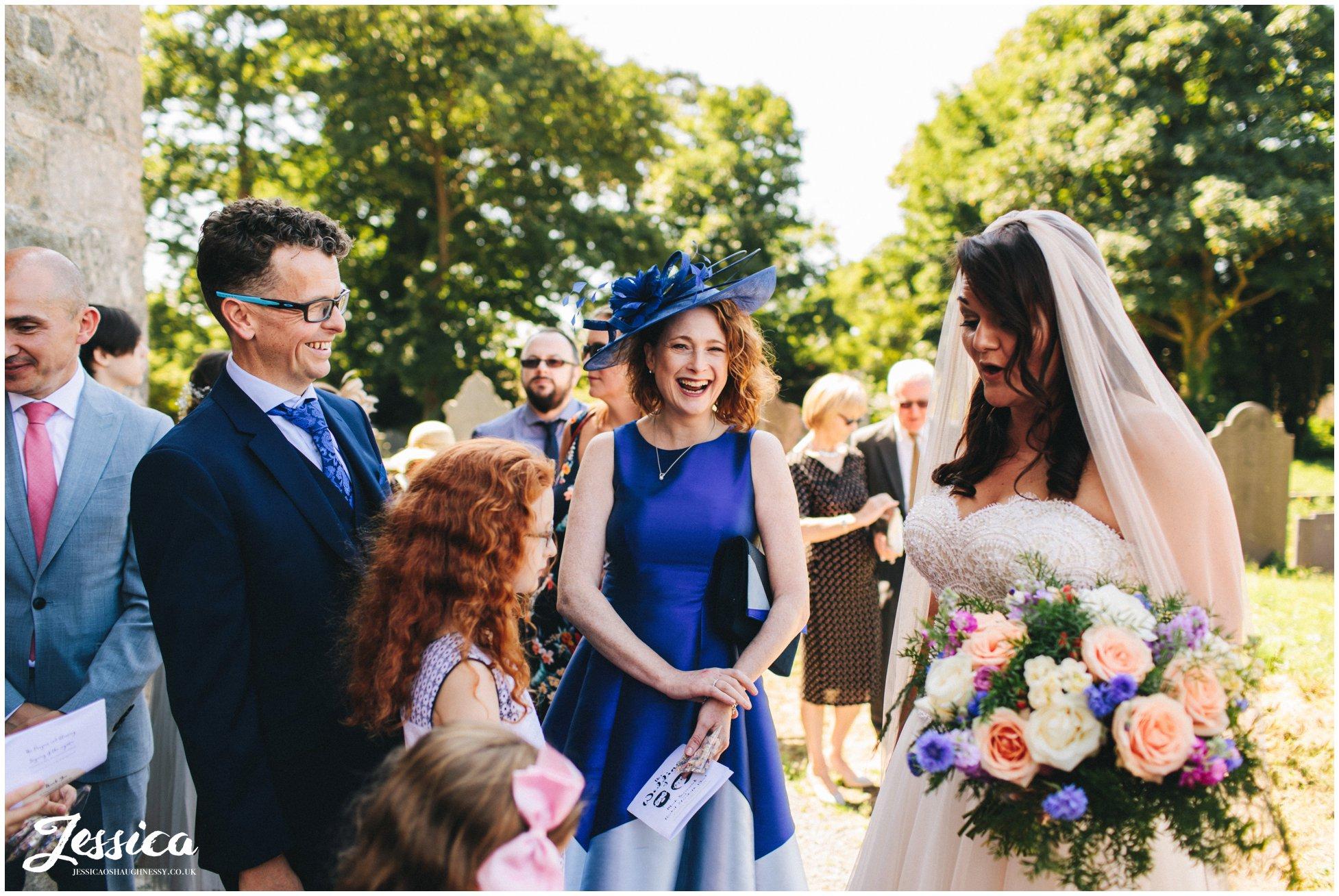 wedding guests congratulate the bride at the north wales wedding