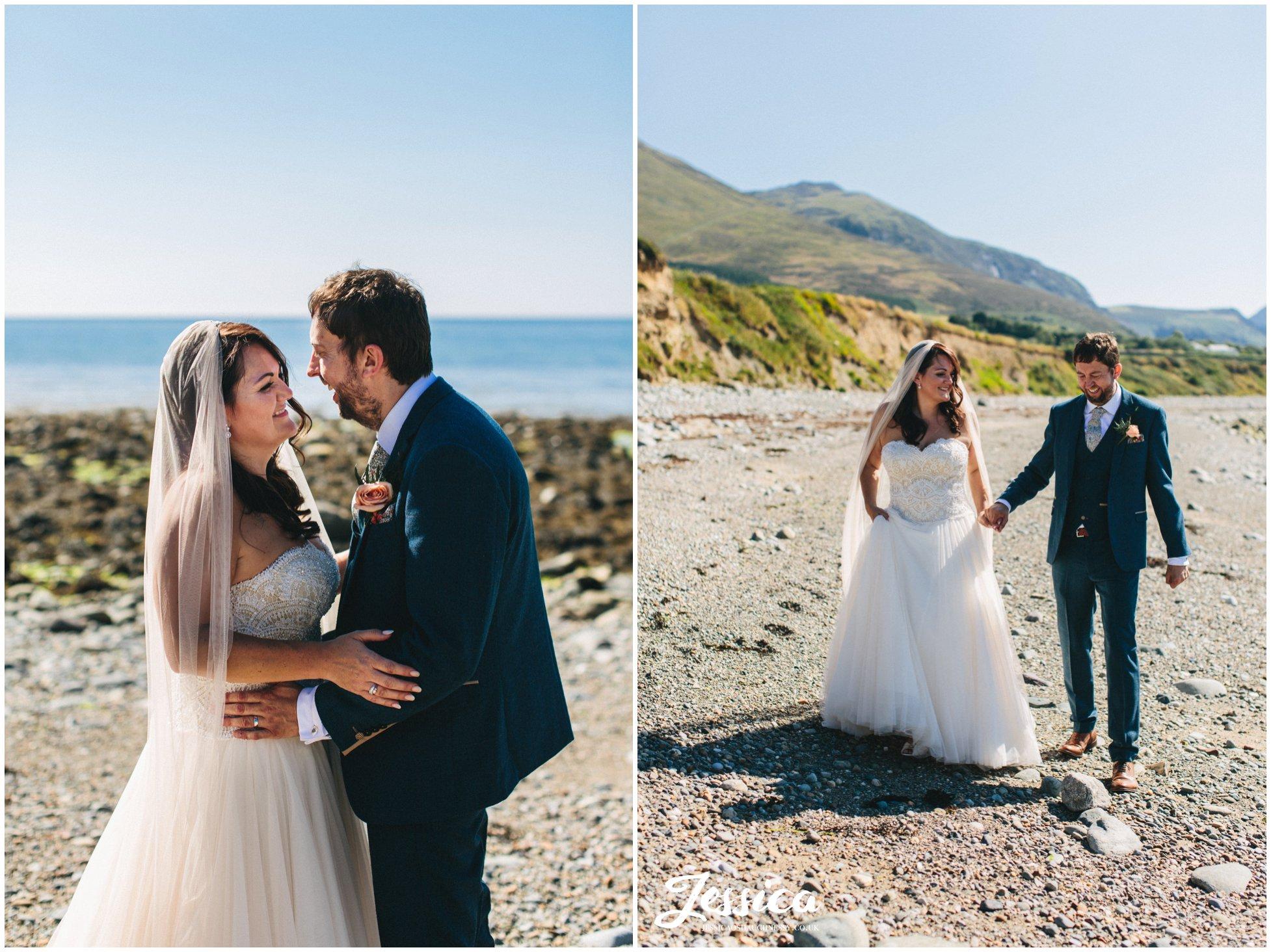 the couple enjoy the sun on Caernarfon bay at their bach wen wedding