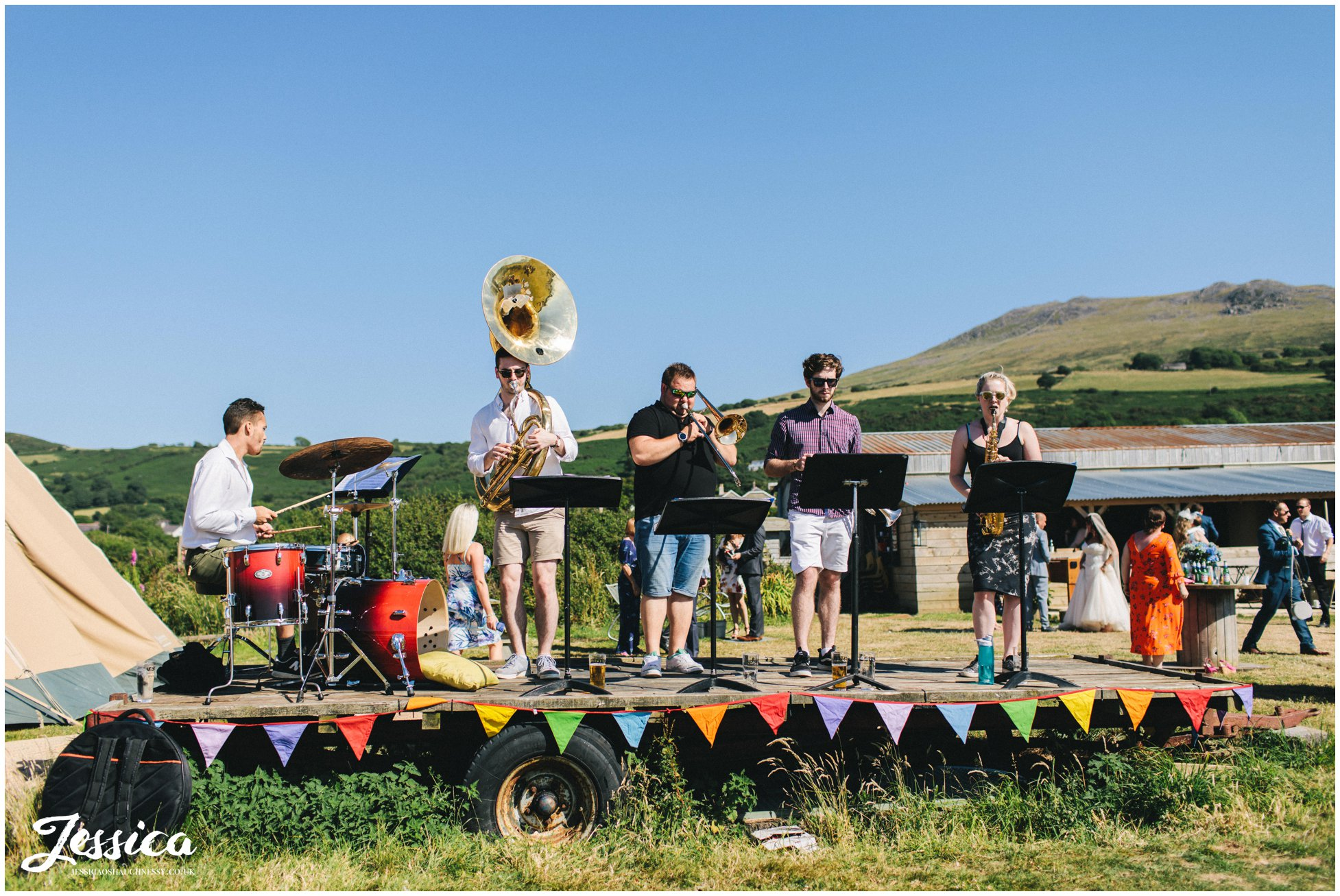 brass band play stood on tractor trailer in north wales