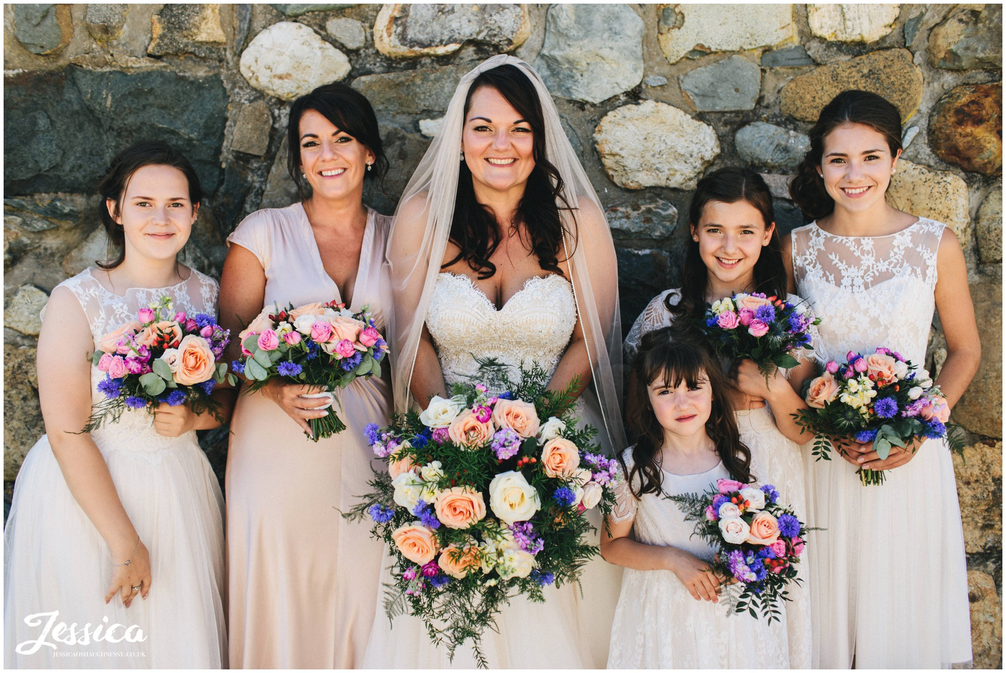 bride poses with her bridesmaids at her bach wen wedding