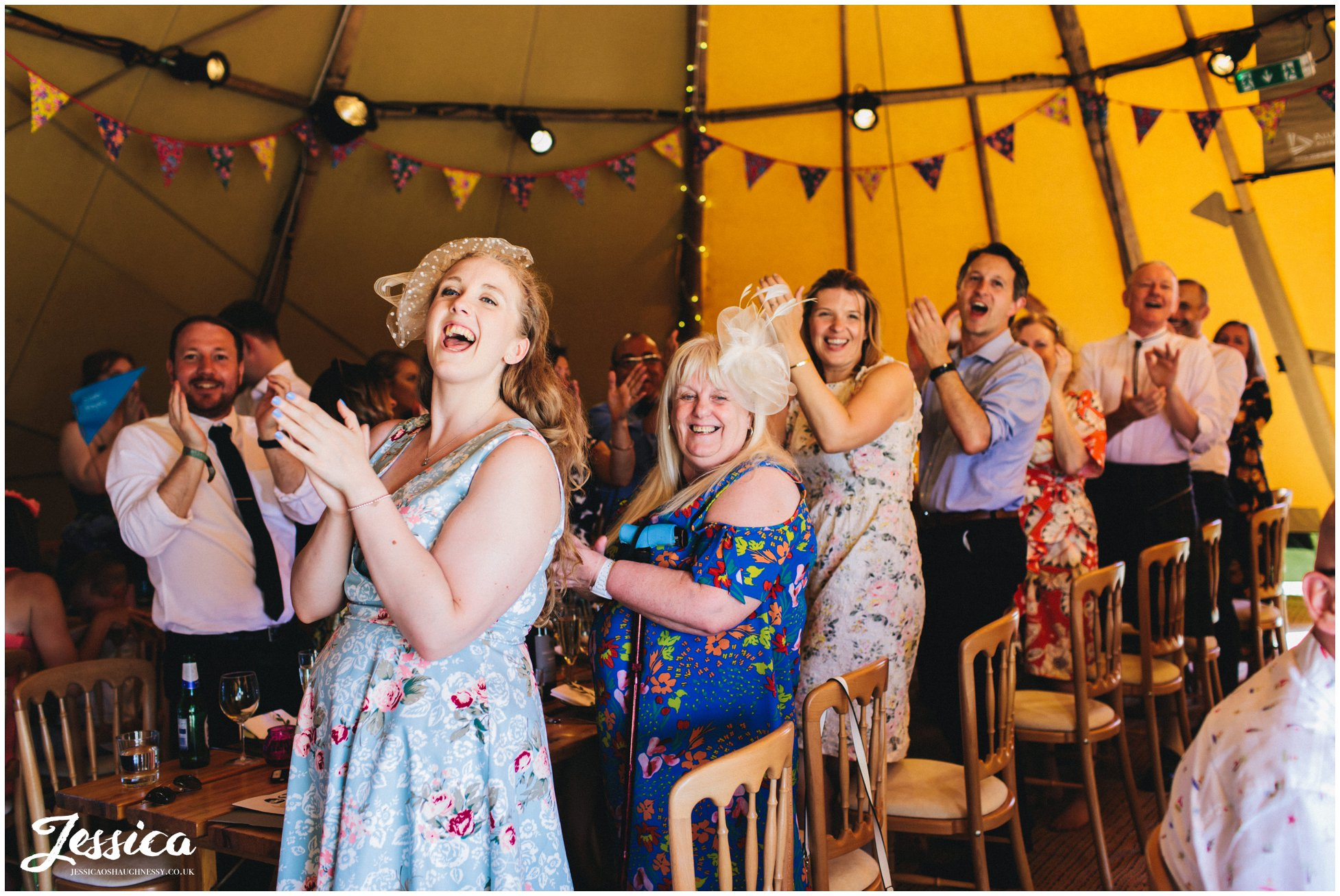 guest applaud the new couple as they enter the tipi at bach wen farm