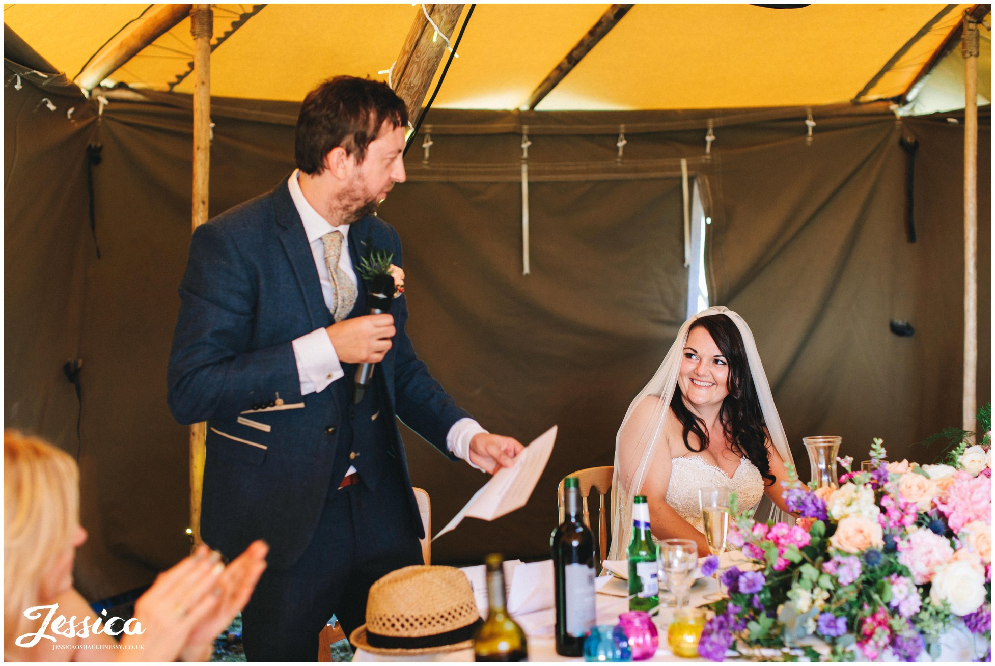 the bride laughs as the groom makes his speech
