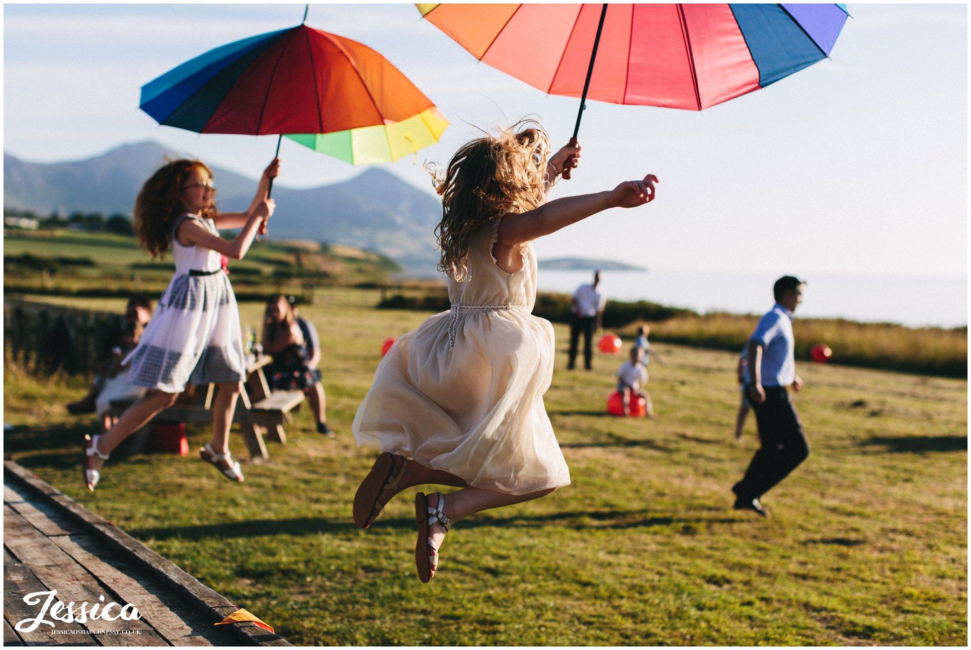 children jump off trailer with rainbow balloons