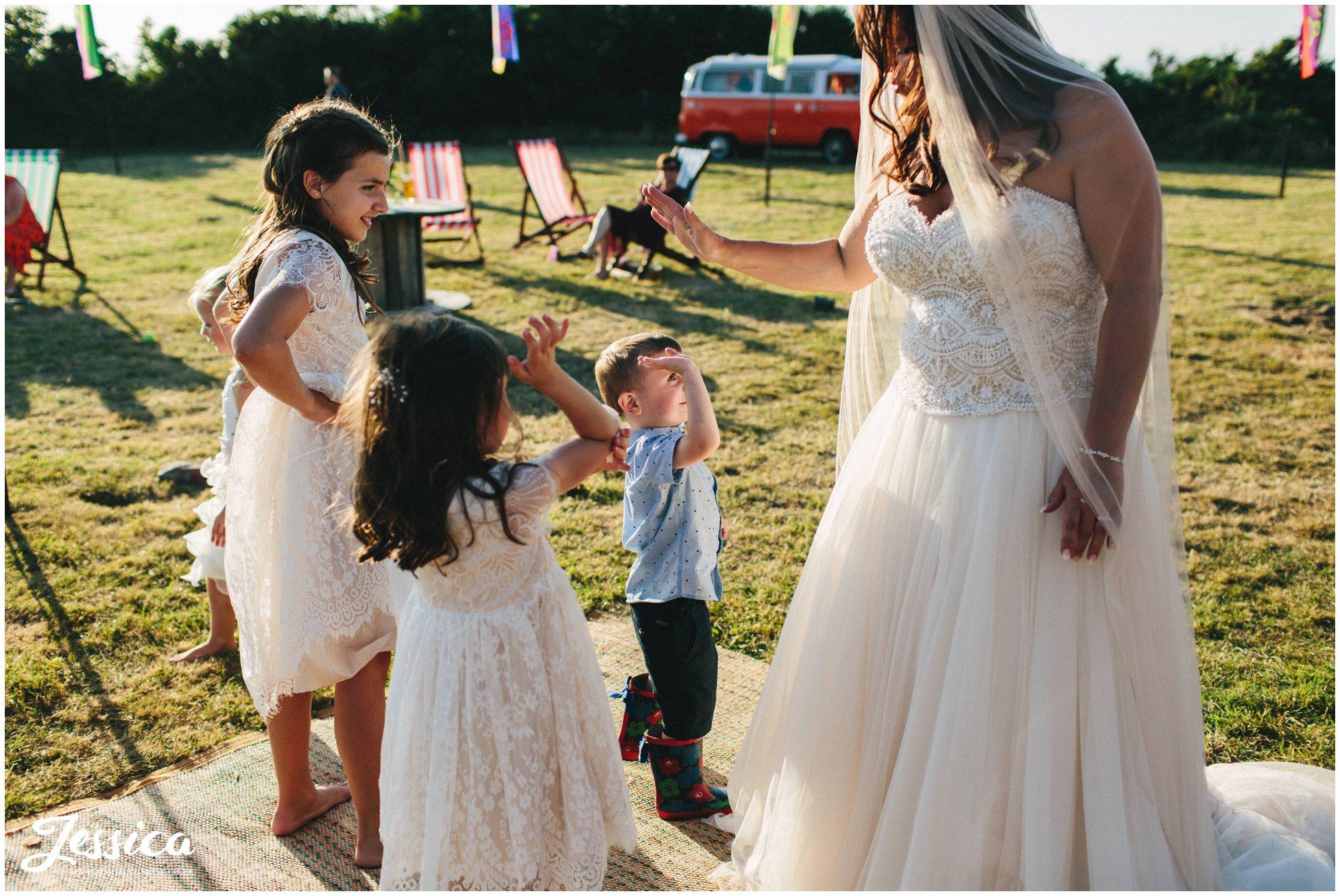children high 5 the bride at her Caernarfon wedding