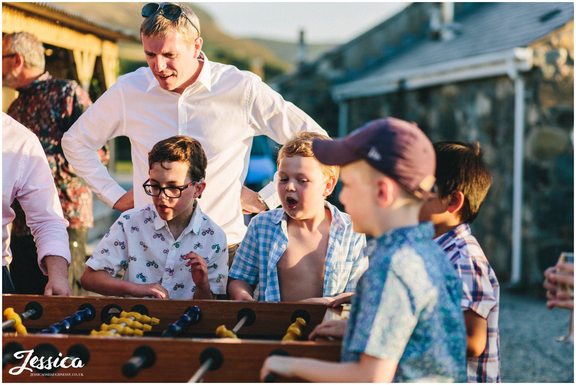 guests cheer as they play table football at bach wen farm in Caernarfon