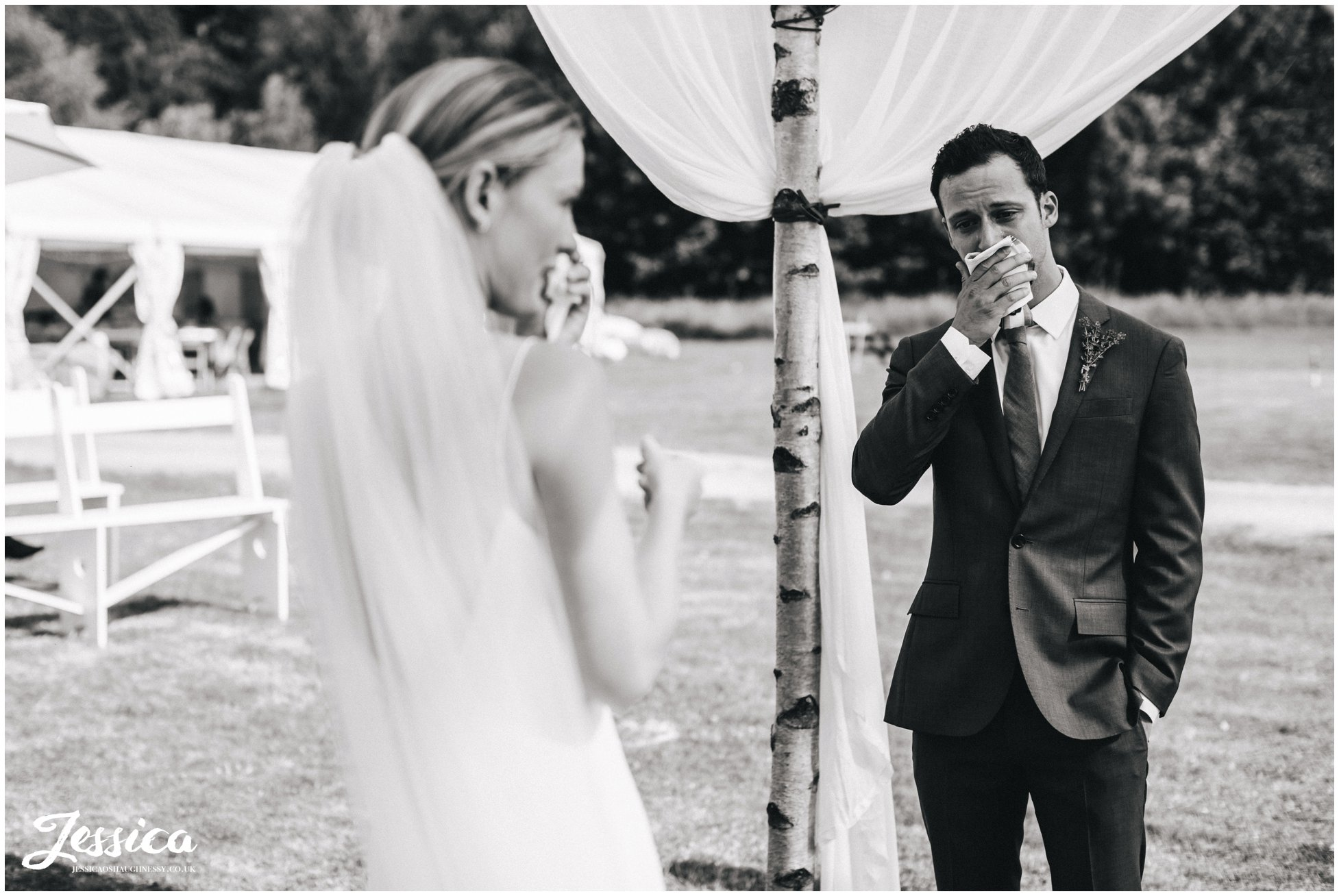 the couple wipe away tears during the emotional north wales wedding ceremony