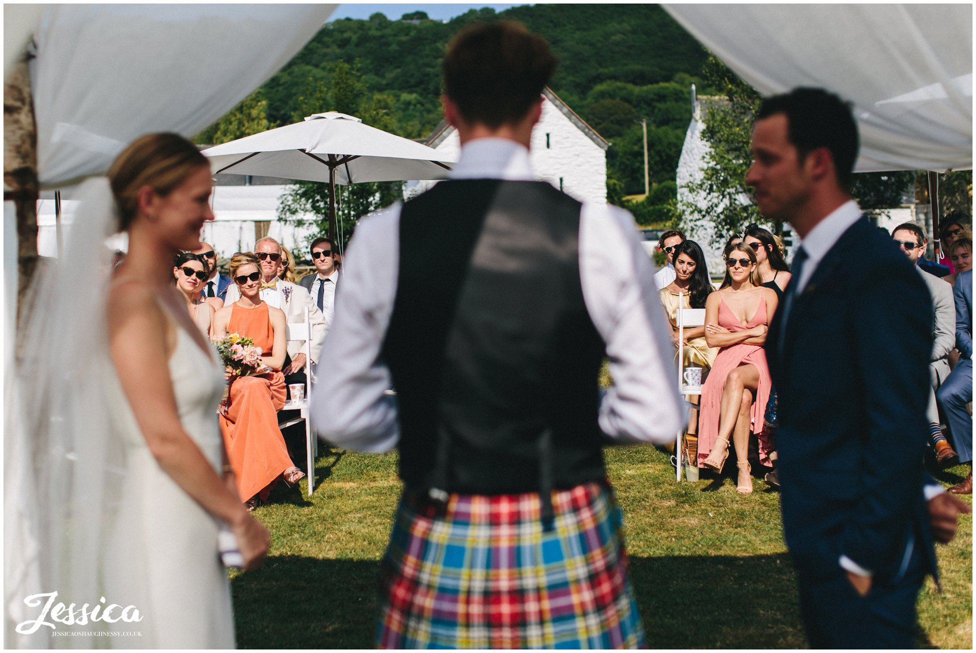 the guests watch the couple during their wedding service