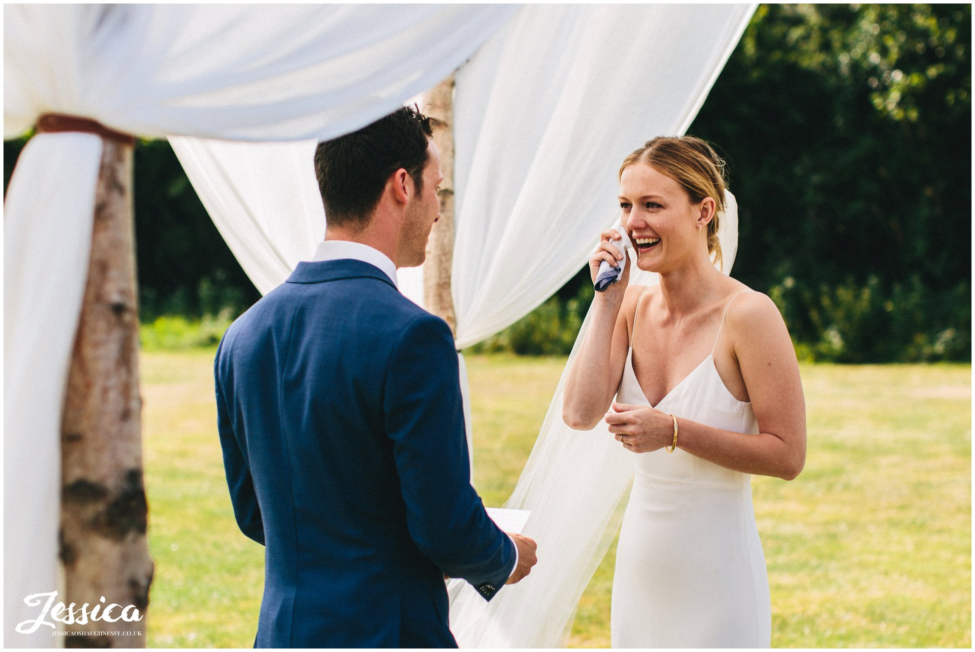 bride shed's a tear during the vow exchange