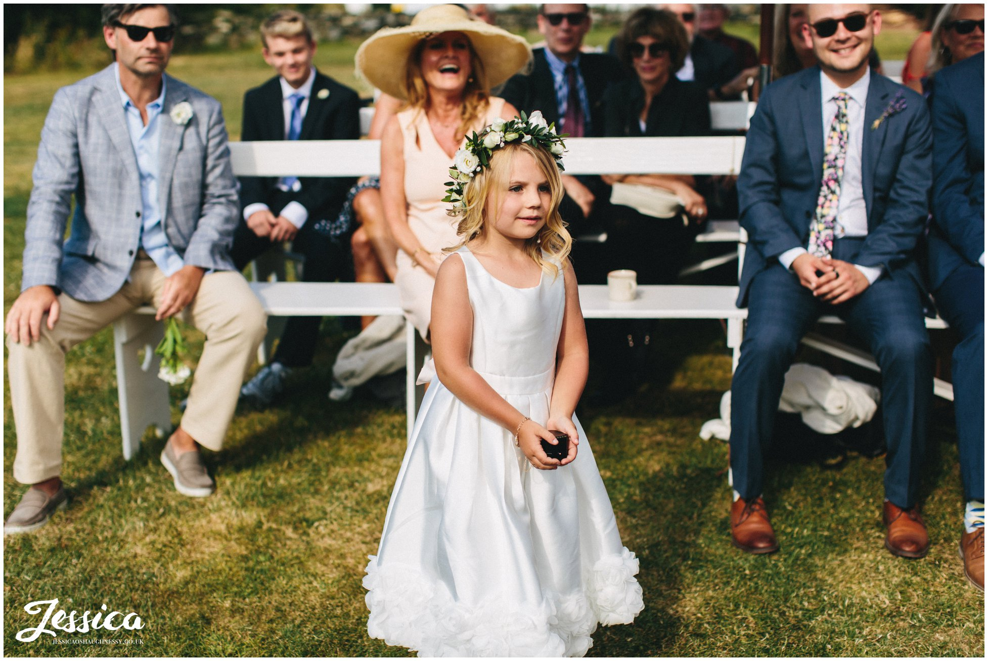 flower girl stands to give the rings