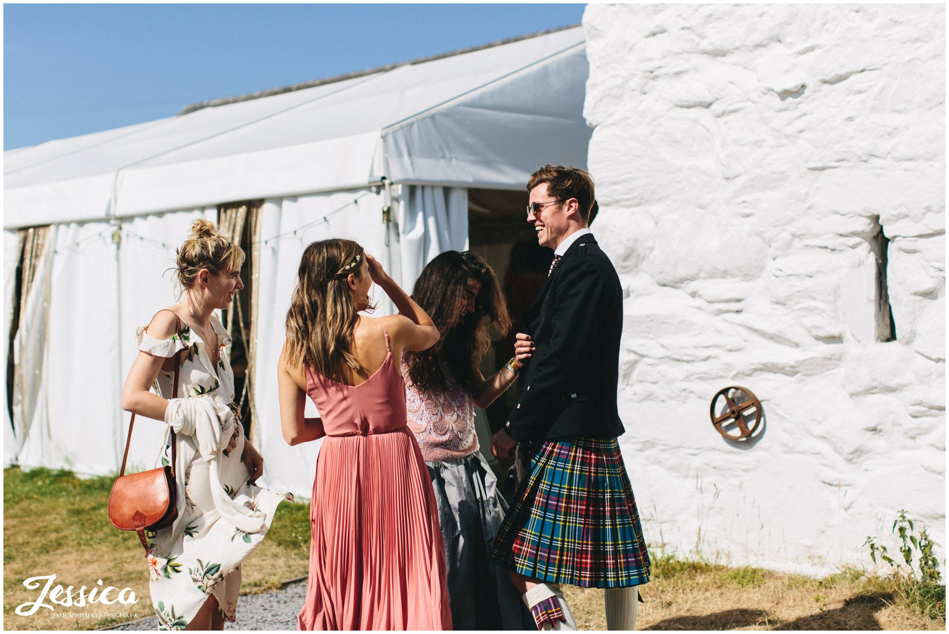 scottish guests wear kilts to the wedding
