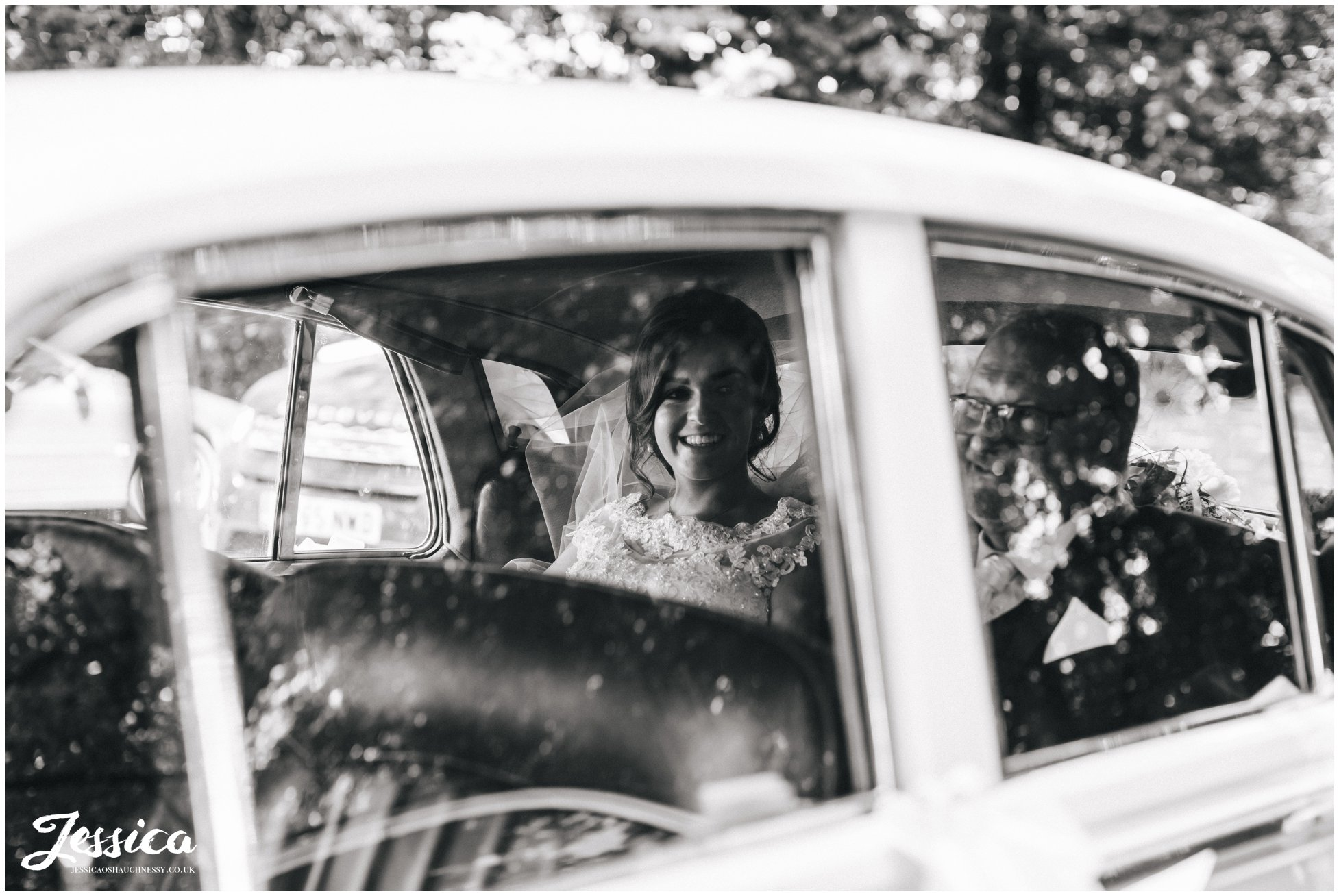 the bride arrives at the lancashire church in the vintage wedding car