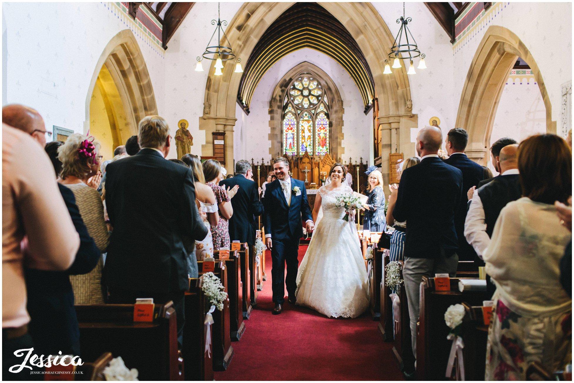 Bride & Groom walk down the aisle as husband and wife