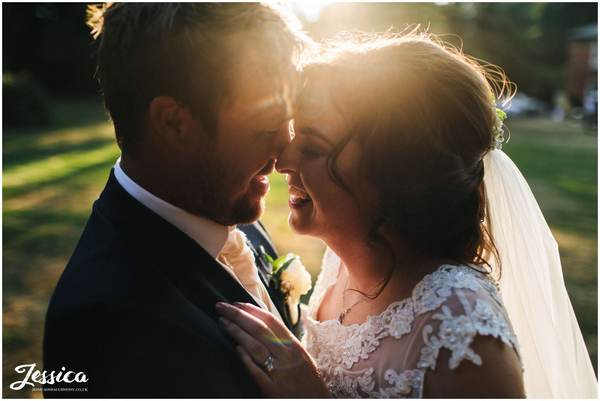close up of the bride & groom laughing in the golden hour