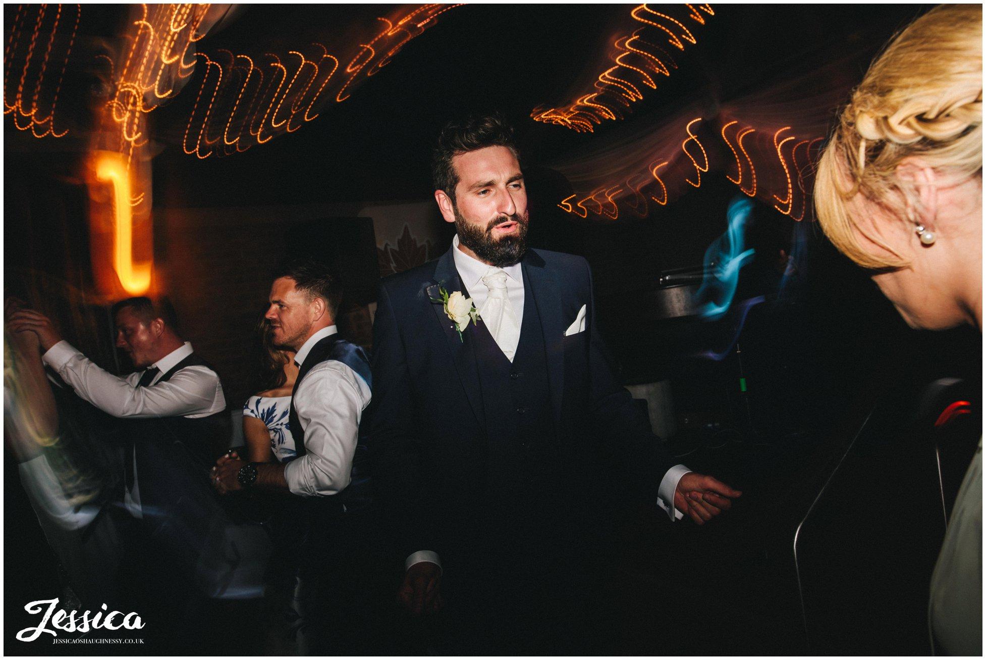 groomsmen dances at the north west wedding venue