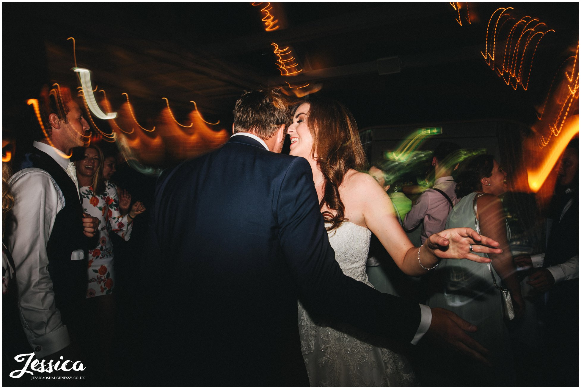 newly wed's dance on the dancefloor at their wedding reception