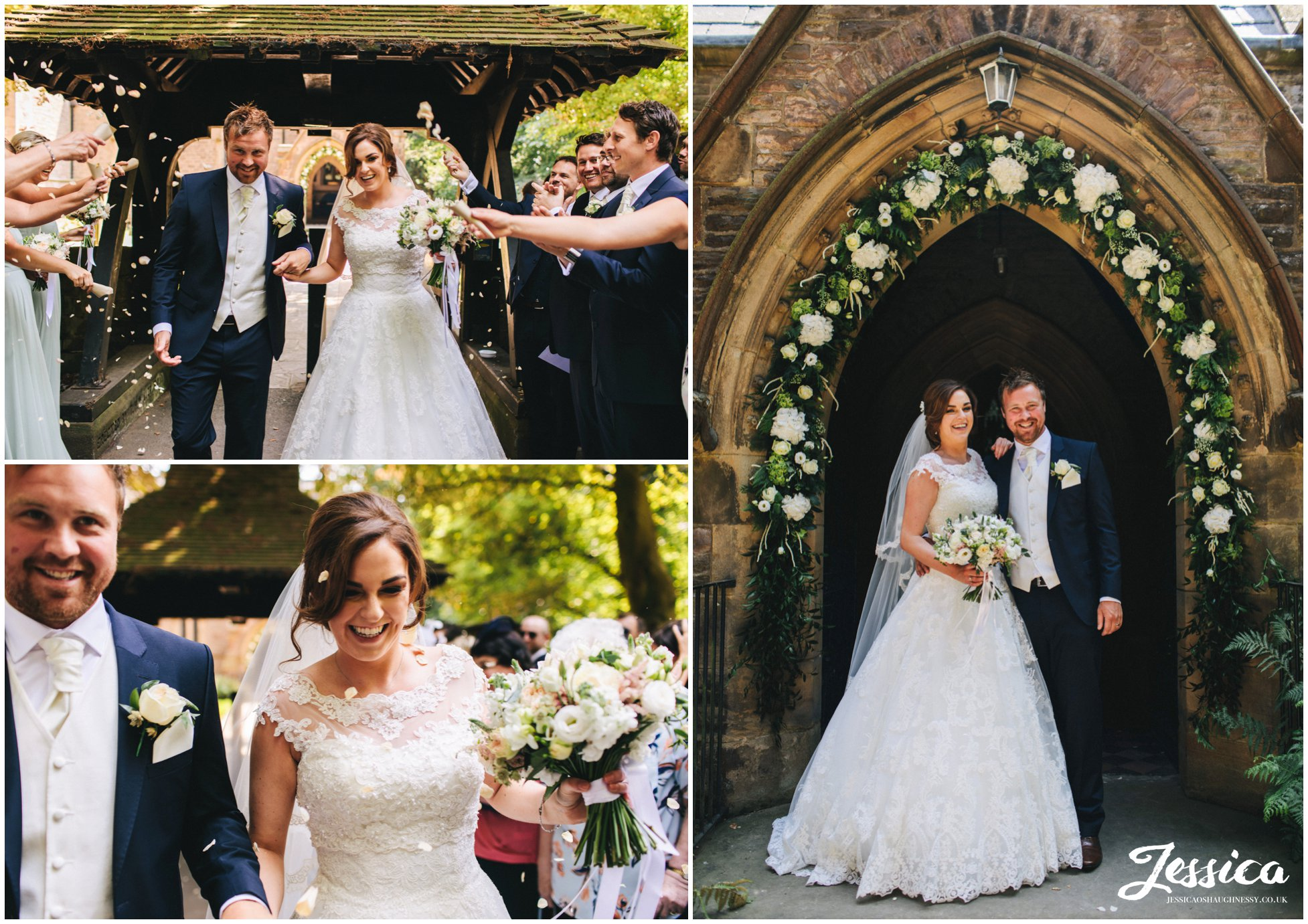 newly wed's stand on the church steps under a floral arch way