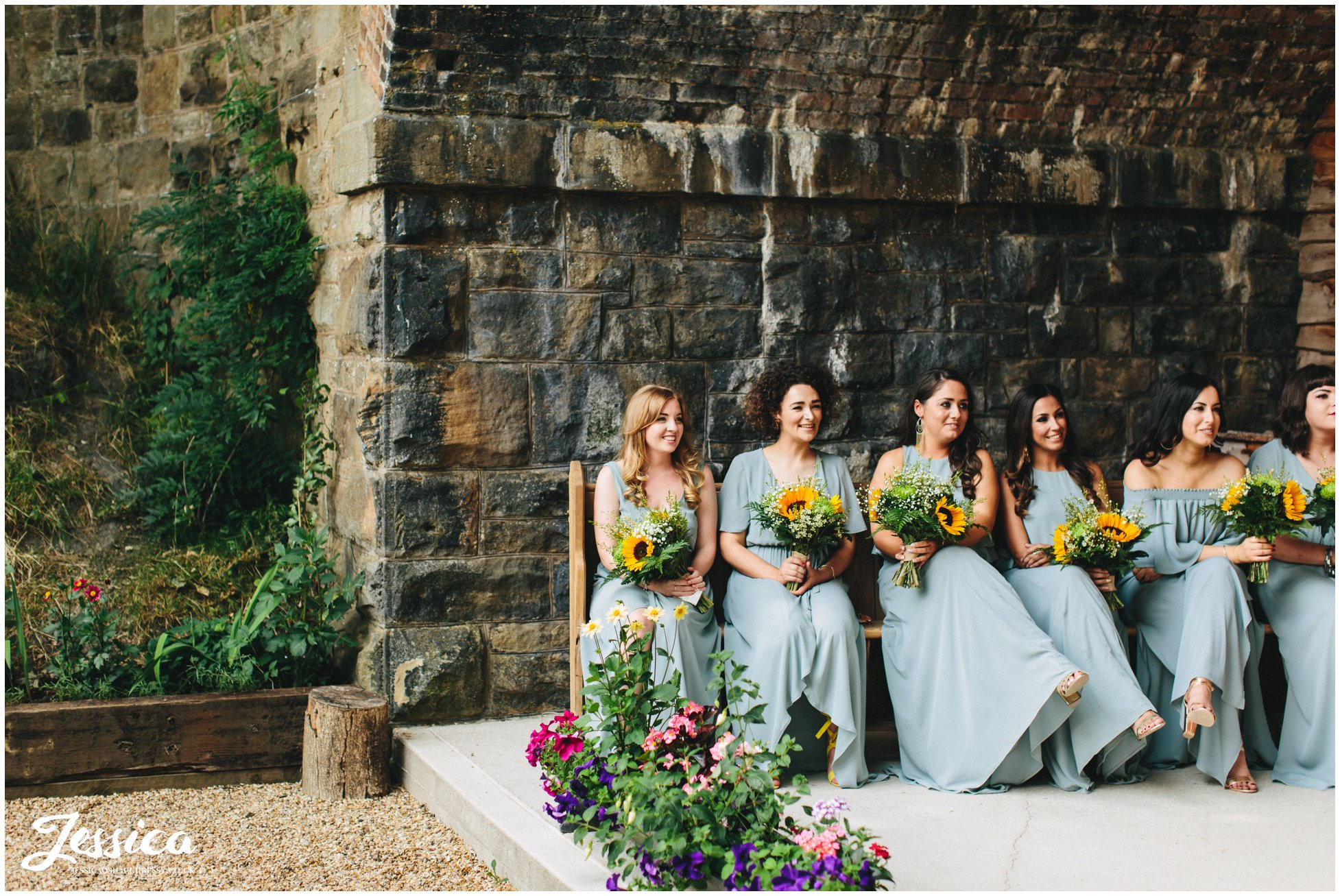 bridesmaids smile during the north wales wedding ceremony