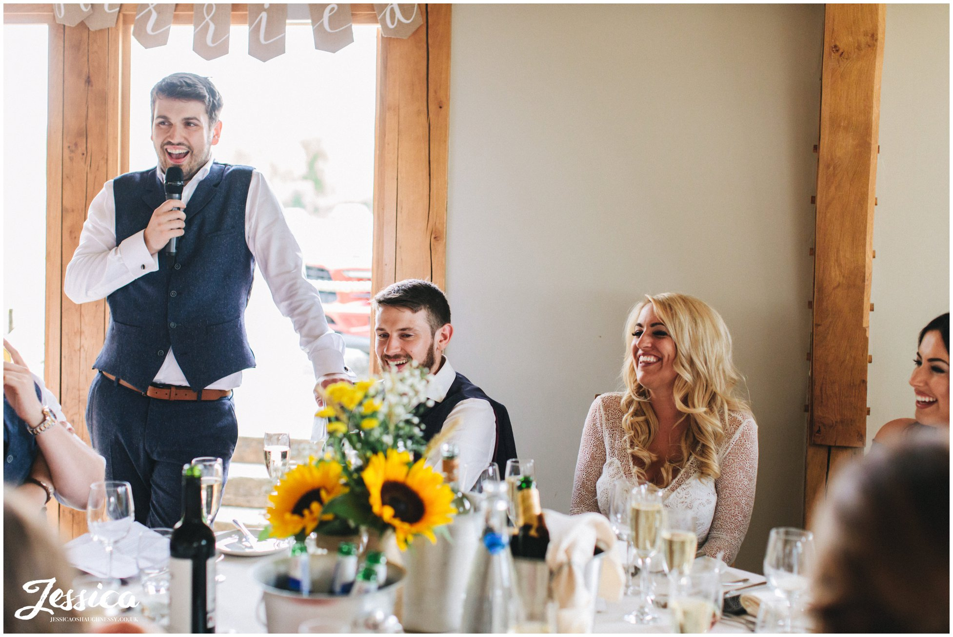groom stands to give his speech at the north wales wedding venue