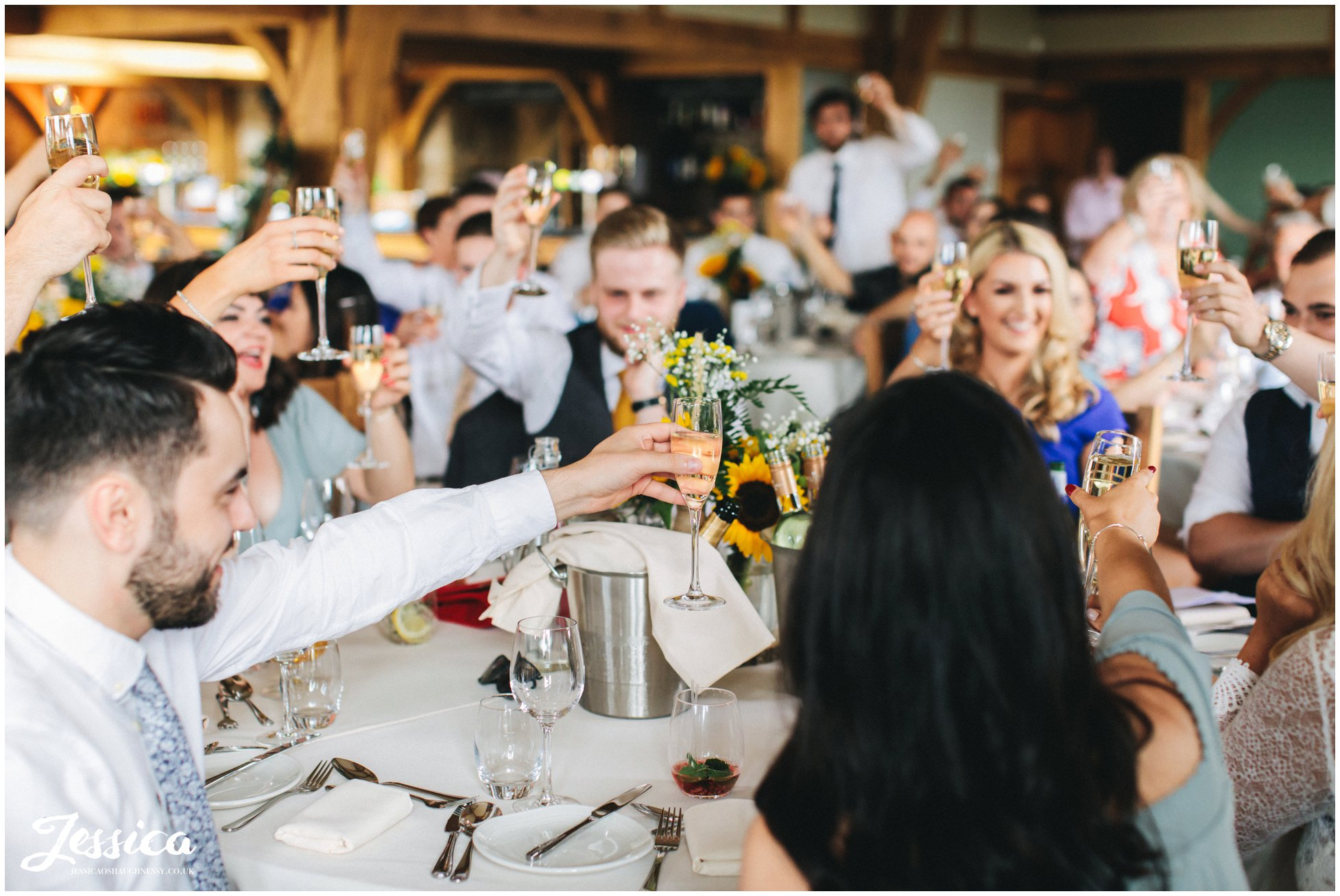 Guests toast with champagne