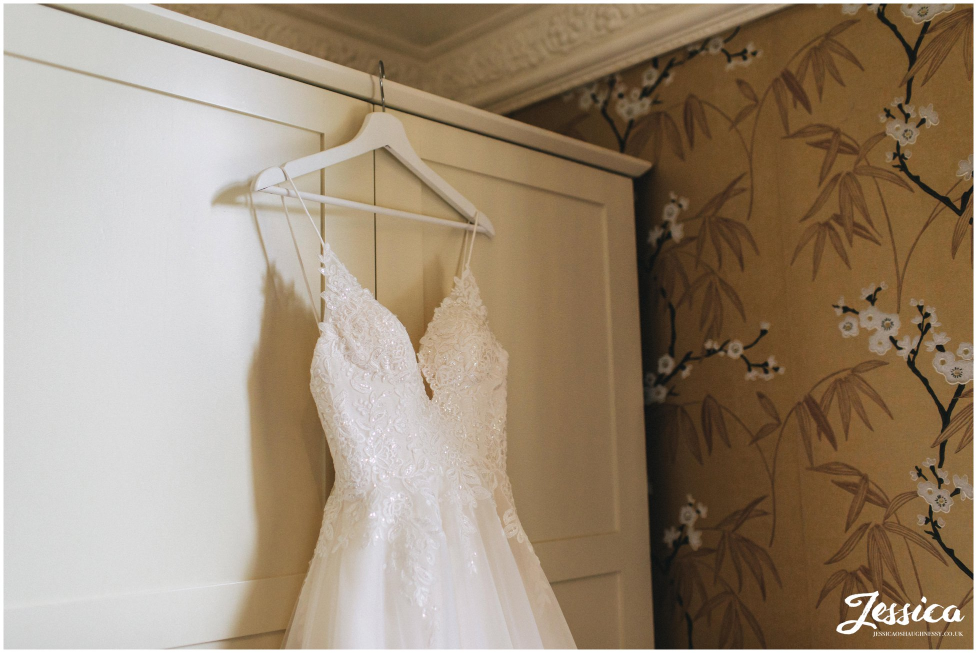 Bride's dress hanging on the wardrobe