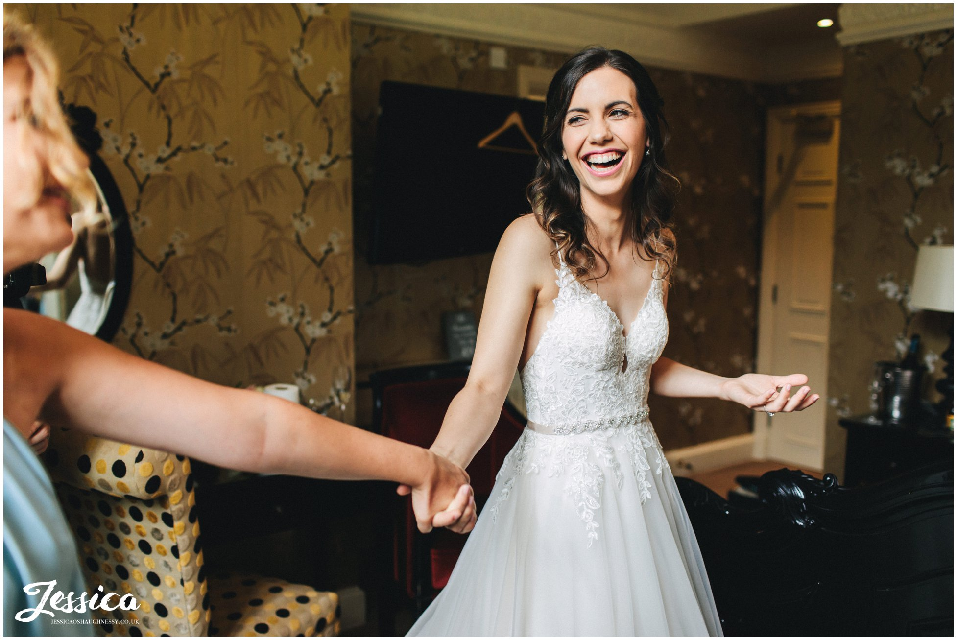 the bride holds her friends hand at inglewood manor