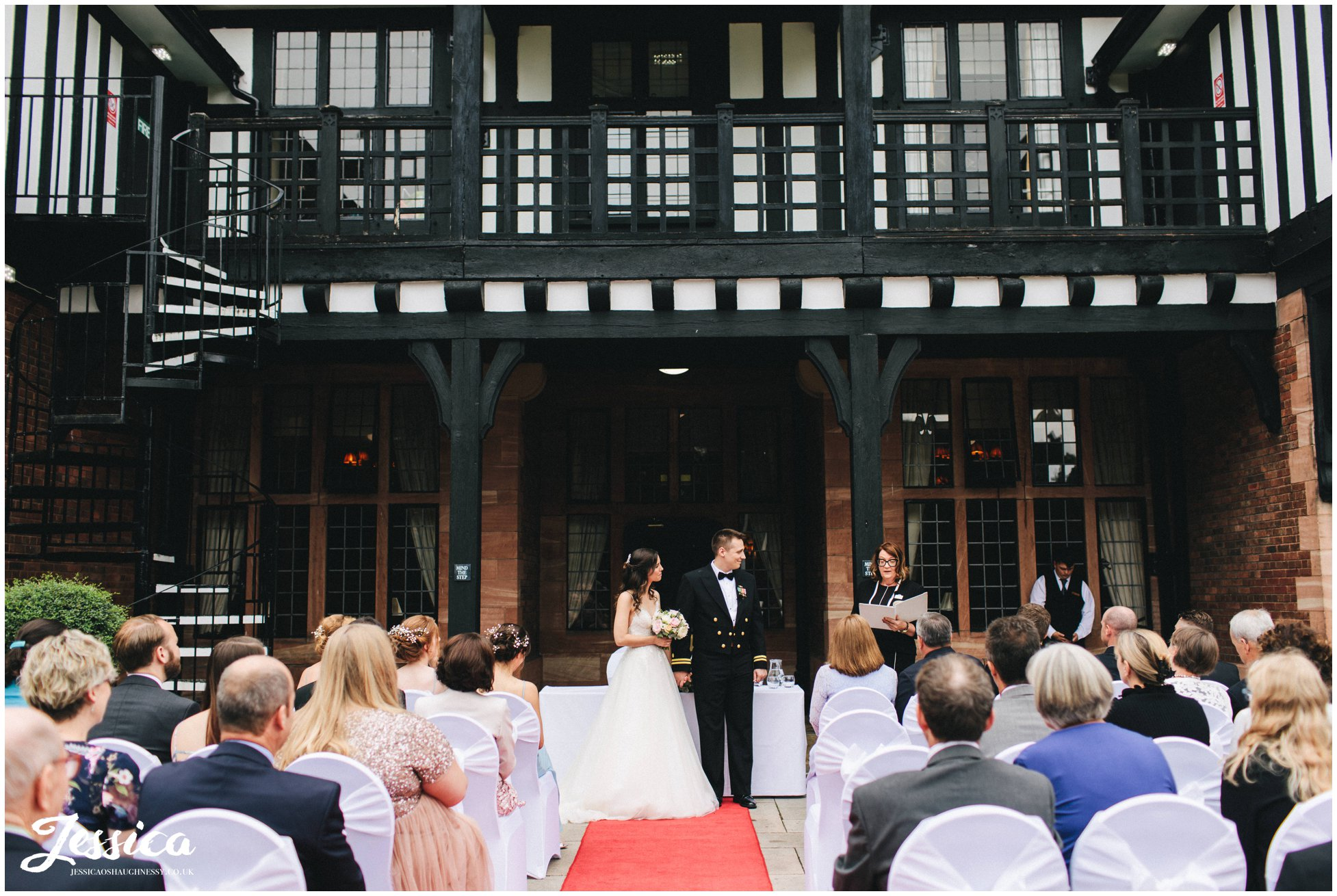 the couple have an outdoor ceremony on the terrace