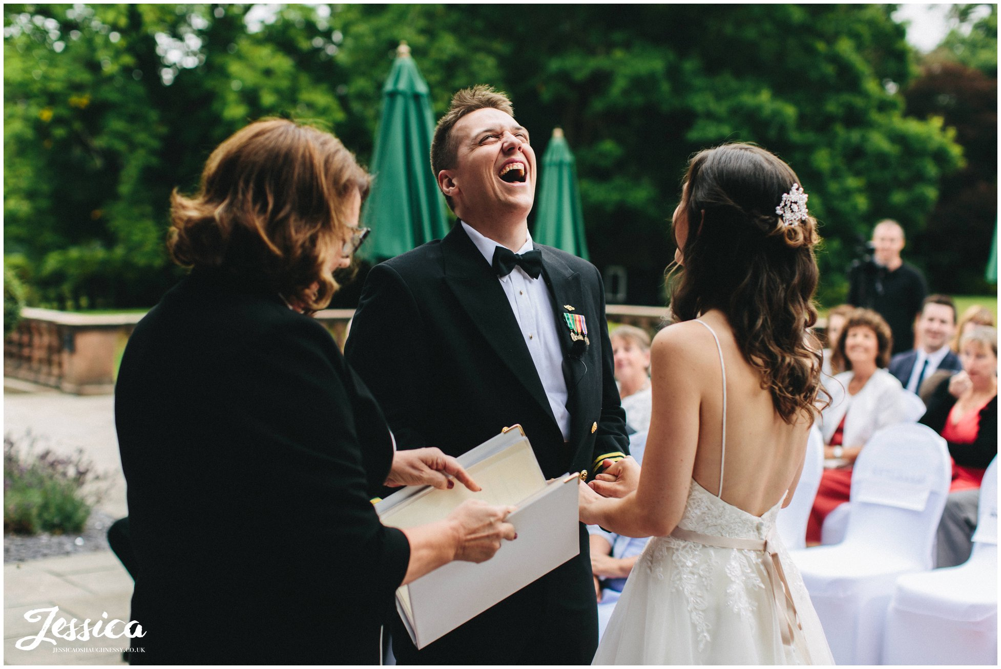 the groom laughs during the ceremony
