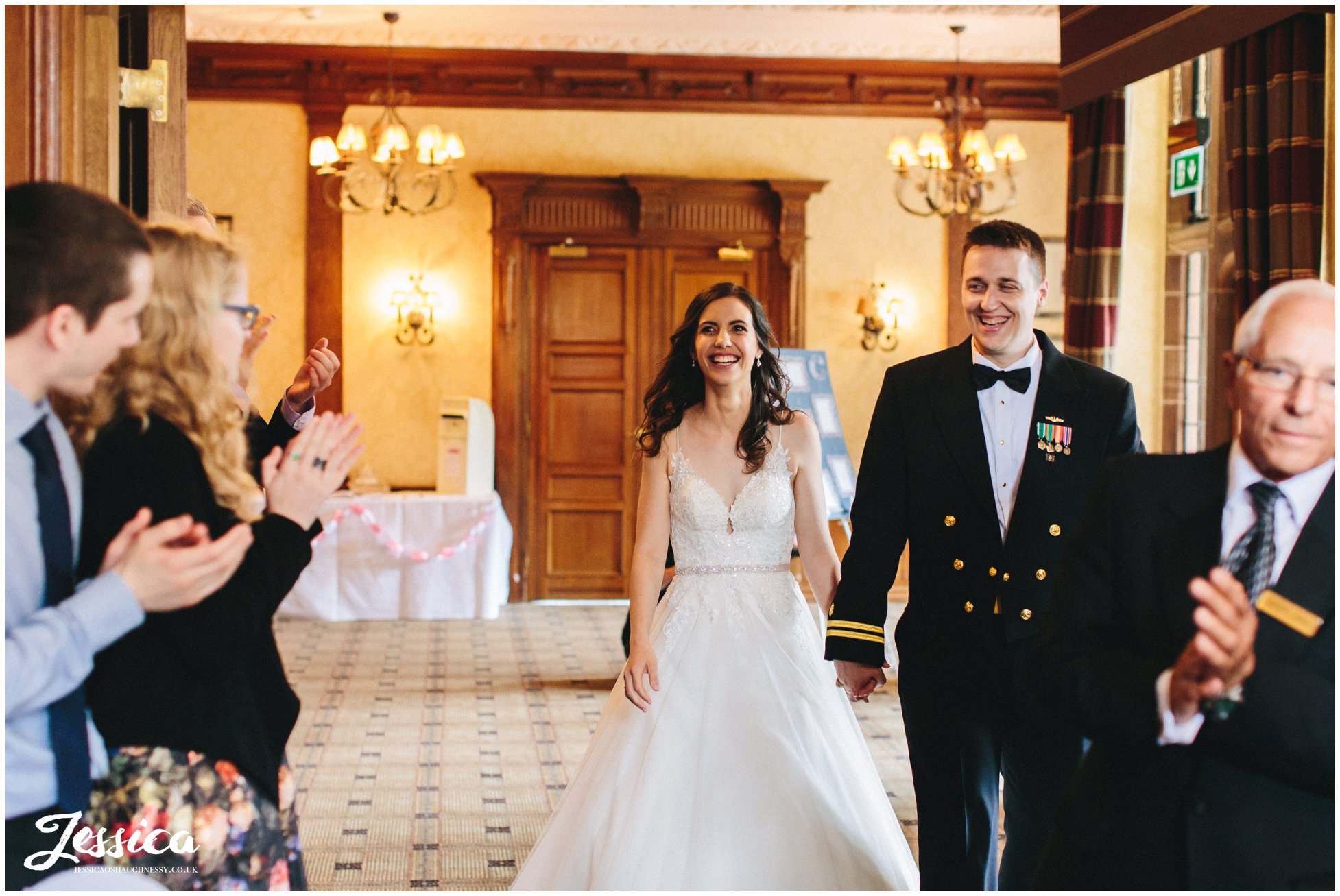couple are announced into their wedding breakfast