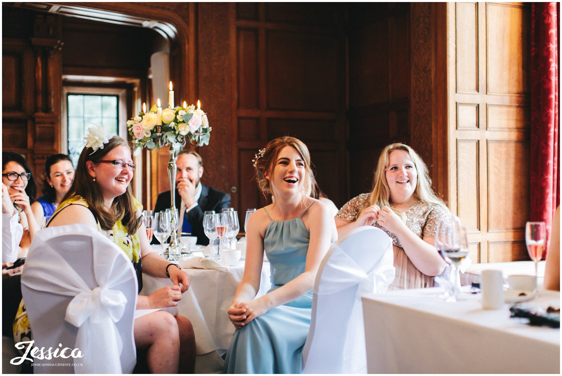 the bridesmaids laugh during the wedding breakfast