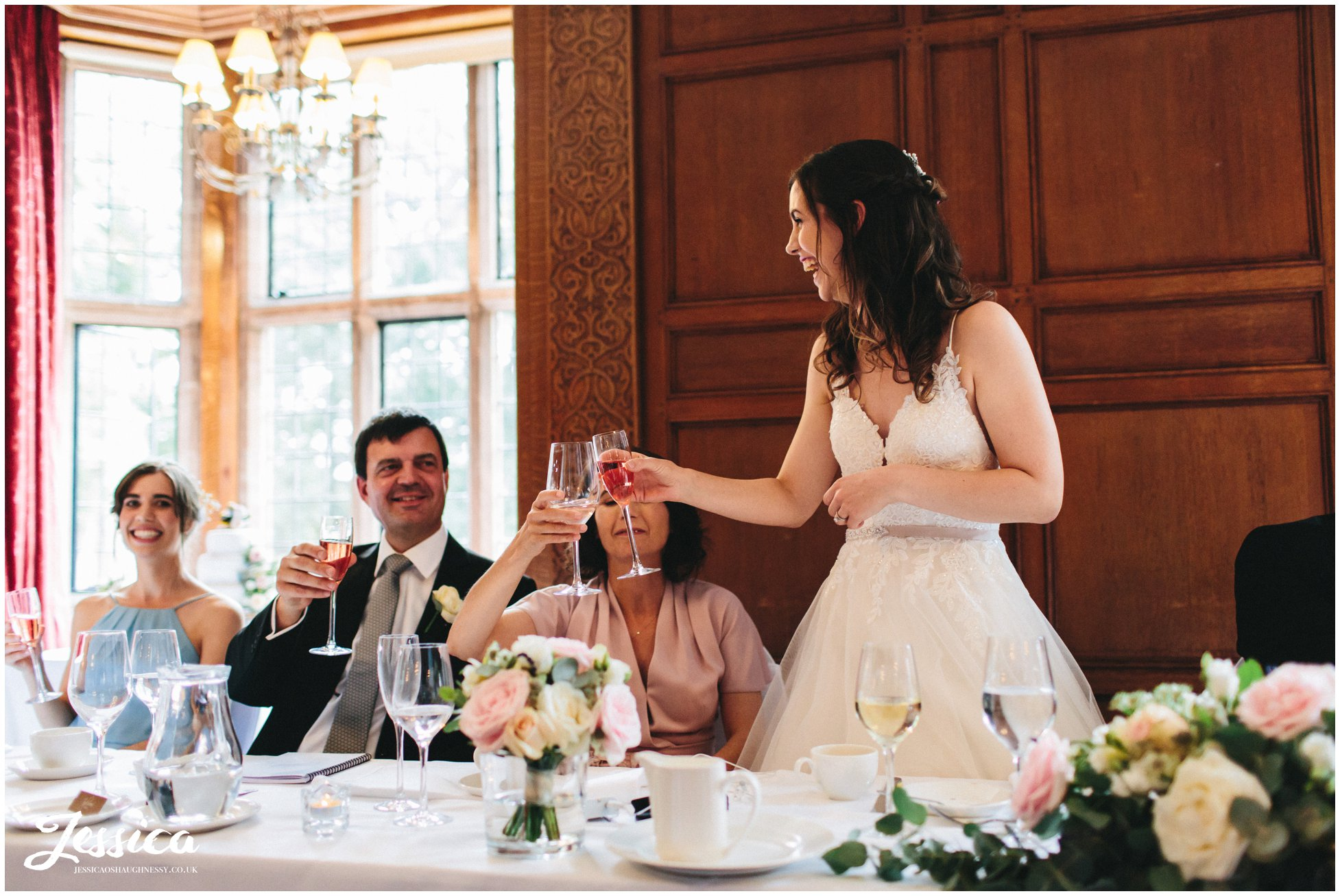 the bride cheers with her family to toast the speakers