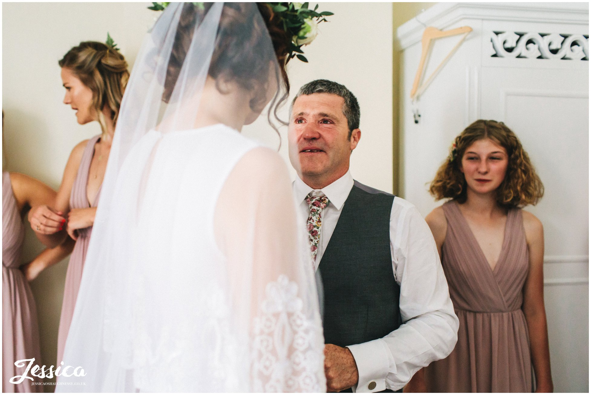 bride's father cries when he see's her