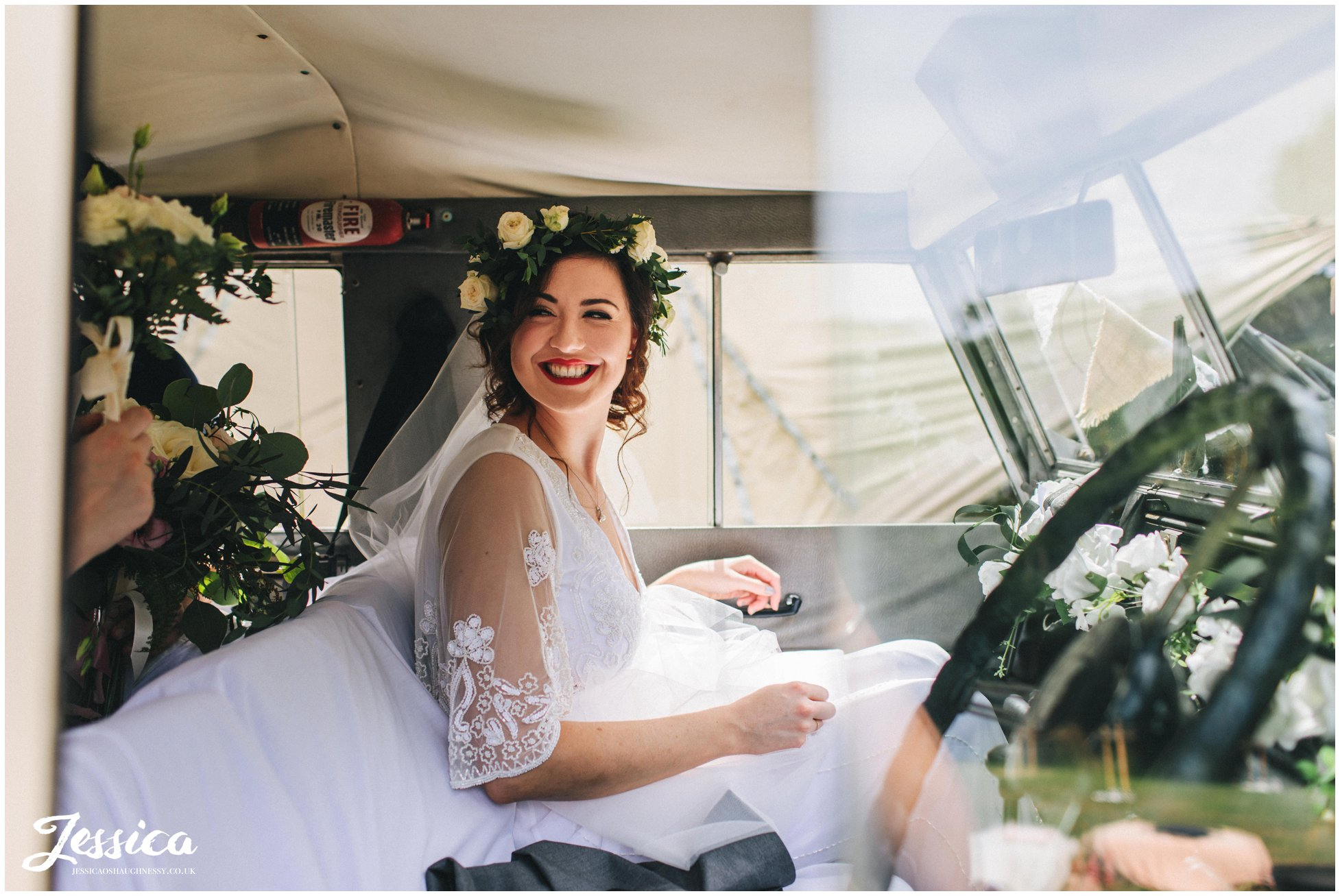 bride arrives in her fathers jeep