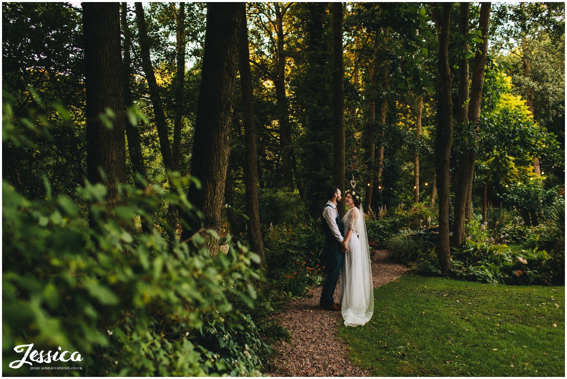 newly wed's hold hands at their woodland wedding in cheshire