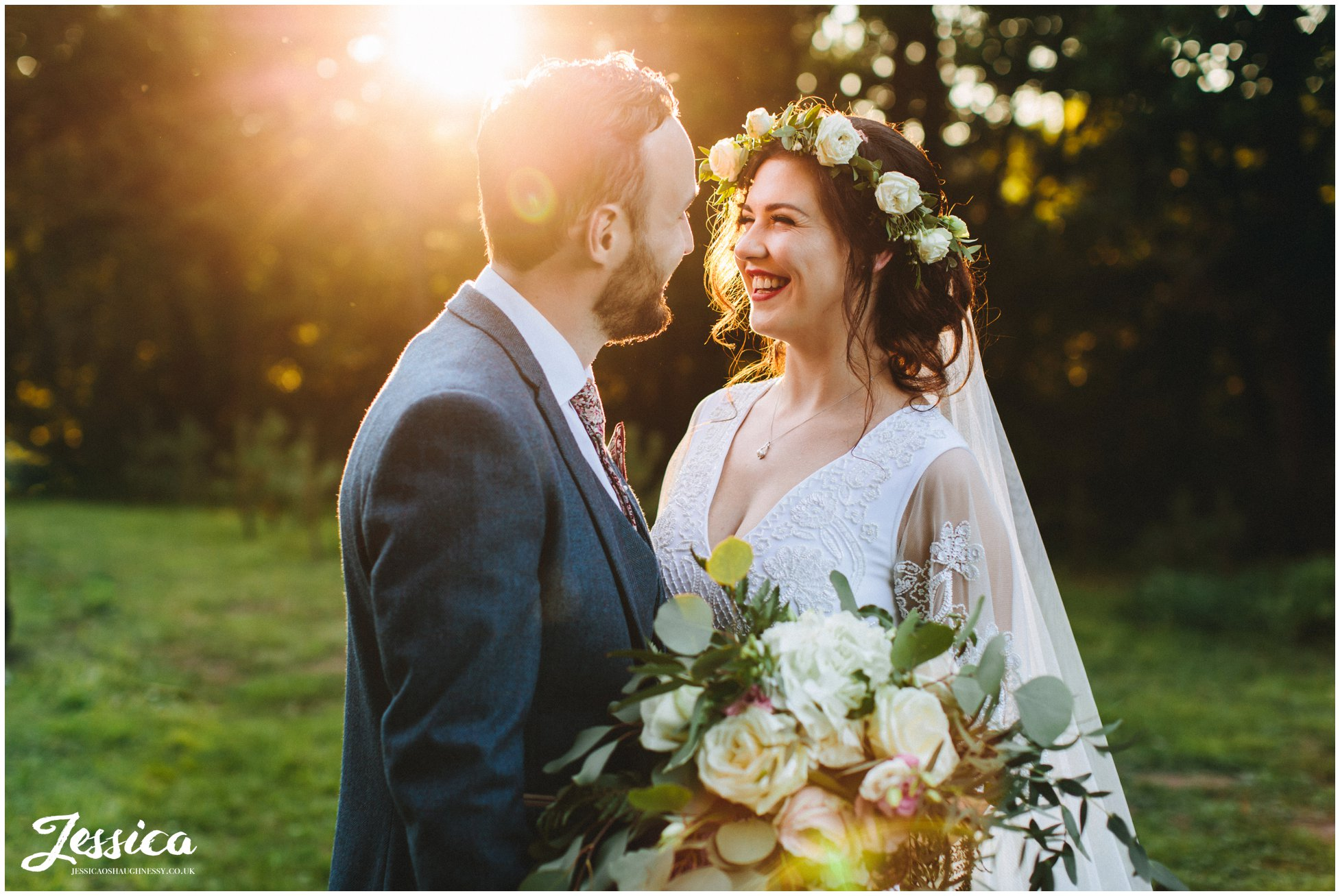 bride laughs at groom during golden hour